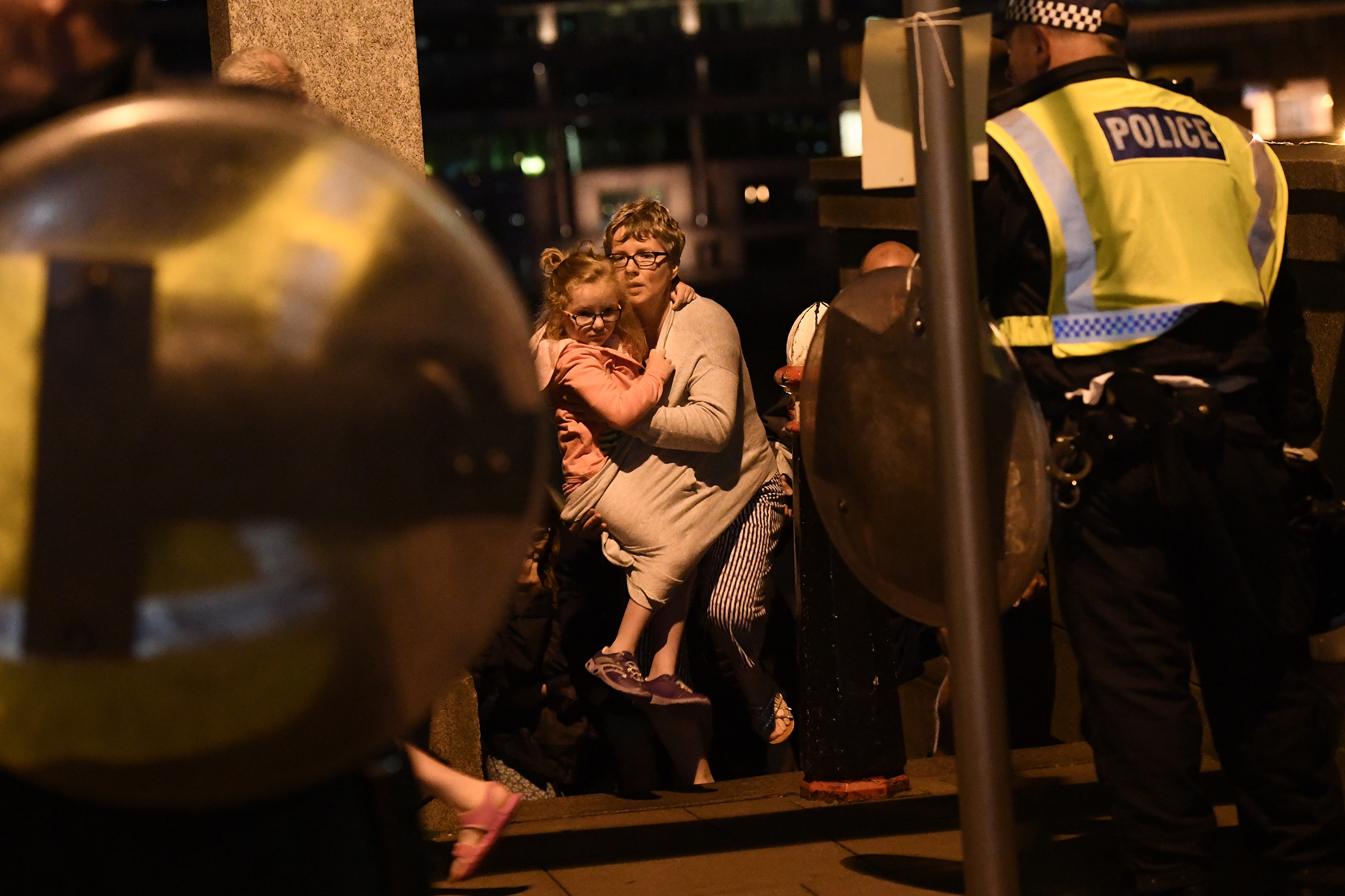 A woman and young girl are lead to safety on Southwark Bridge, away from London Bridge, after an attack on June 4, 2017.