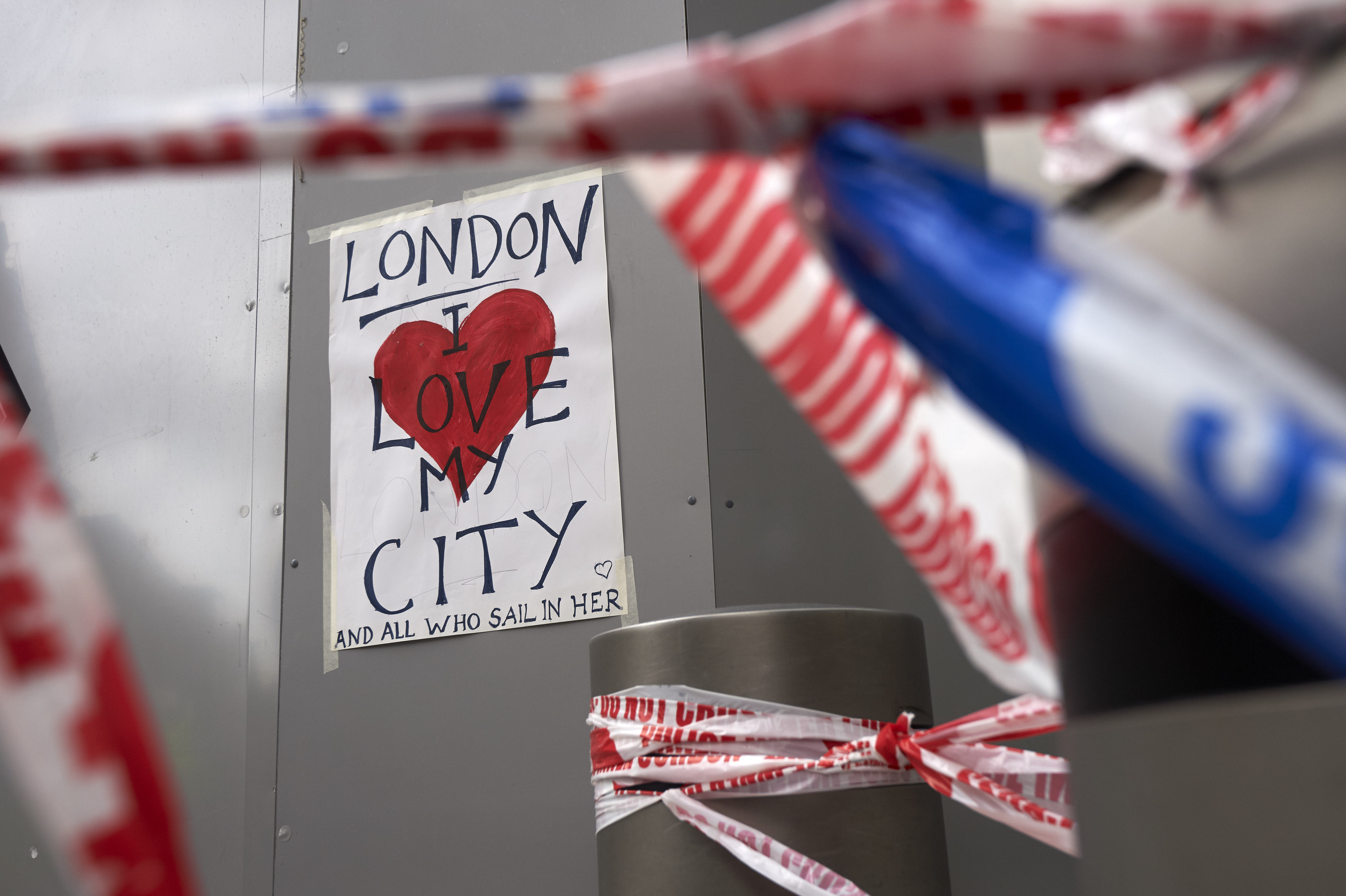 A poster in solidarity is seen on a hoarding outside London Bridge railway station in London on June 5, 2017 at the cordon near the police scene of the June 3 terror attack on London Bridge and the nearby Borough Market.