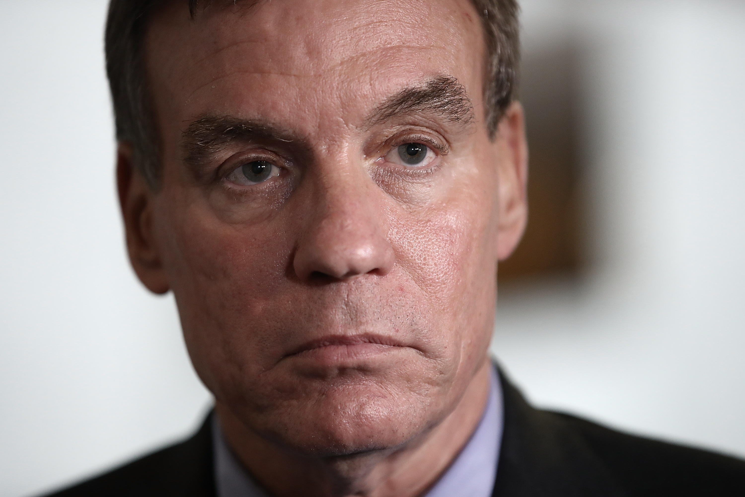 Senate Select Committee on Intelligence ranking member Mark Warner (D-VA) speaks to reporters after a meeting of the committee on Capitol Hill May 23, 2017 in Washington, DC.