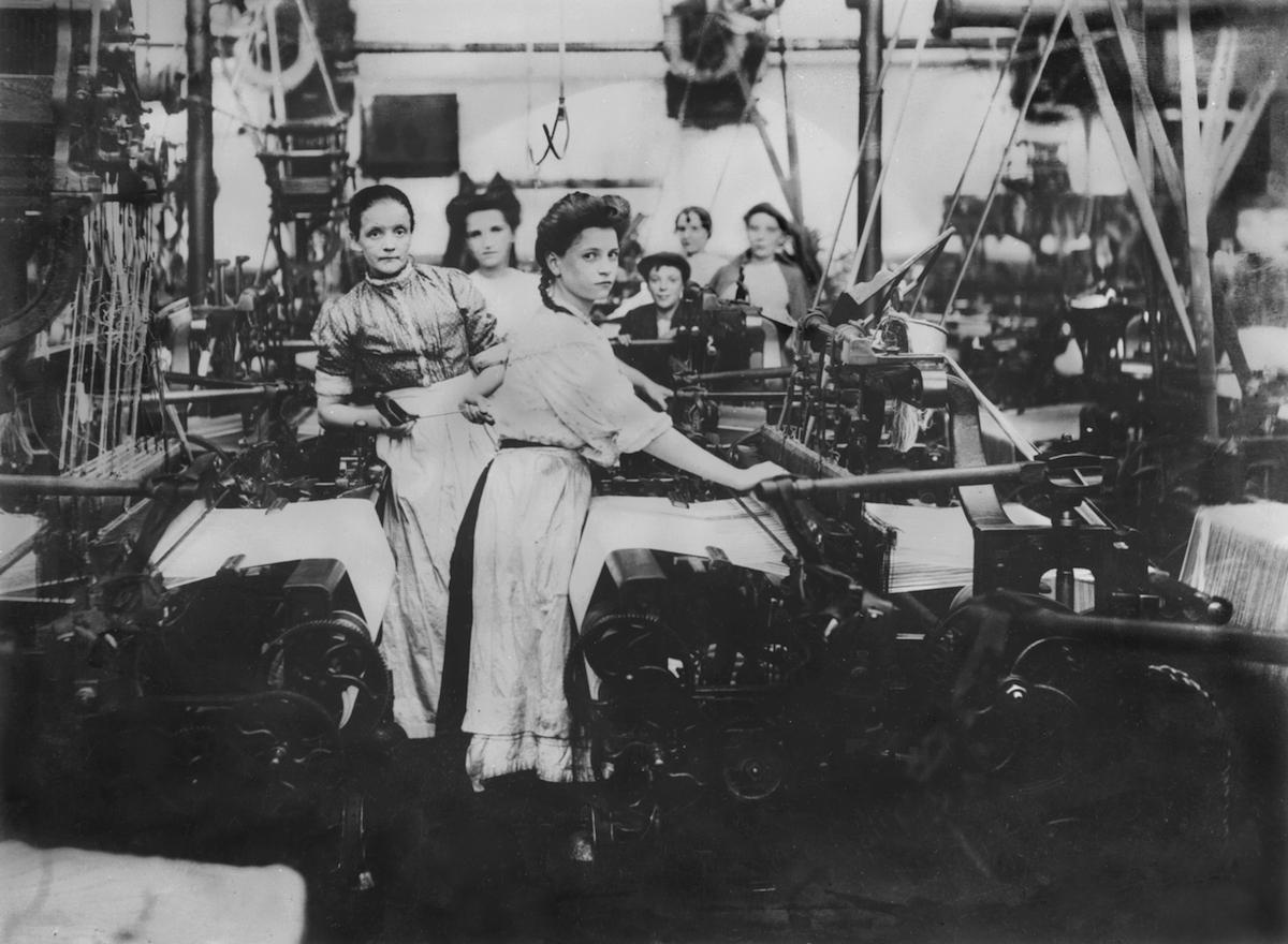 Mill Girls in Lancashire at their machines, circa 1890.