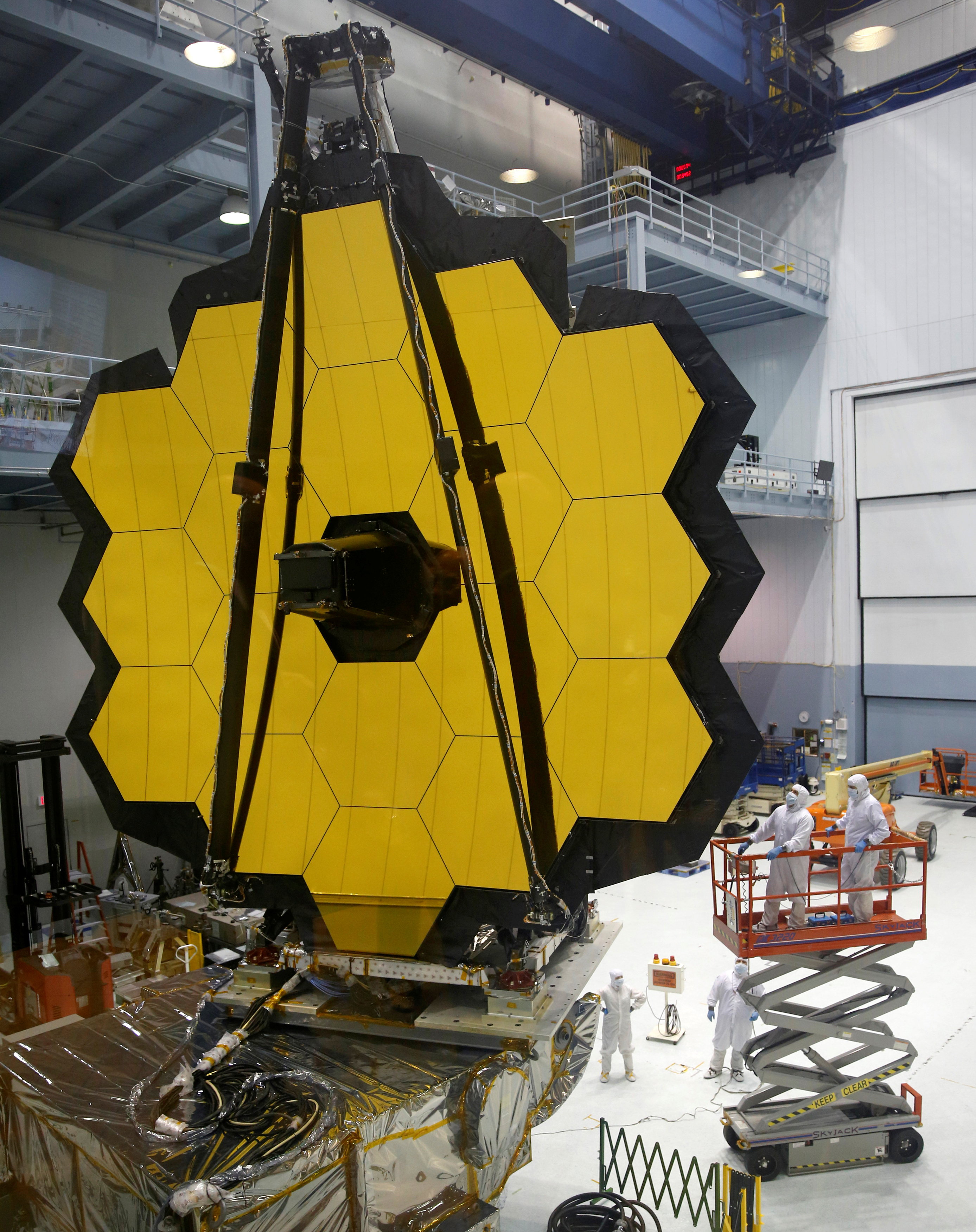 NASA workers look up at the James Webb Space Telescope Mirror during it's media reveal at NASAís Goddard Space Flight Center at Greenbelt, Maryland on Nov. 2, 2016.