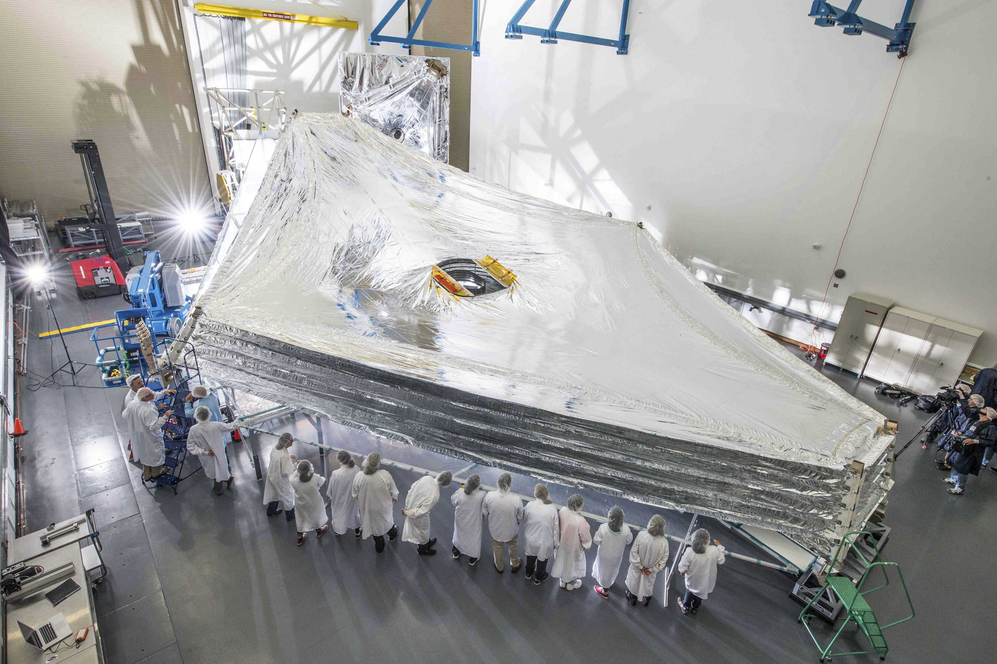 The Sunshield test unit to be used on NASA's James Webb Space Telescope is stacked and expanded at a cleanroom in the Northrop Grumman facility in Redondo Beach, Calif. on July 25, 2014.