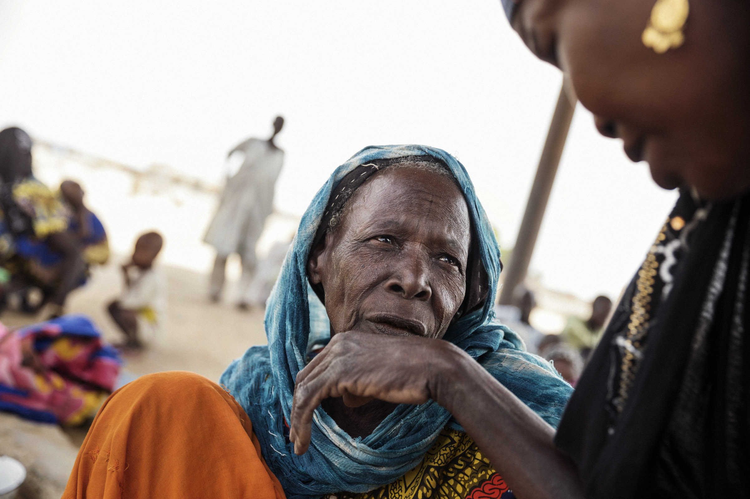 After walking a day and a half, Falta Abada arrives at a screening center for IDPs, Dikwa, Nigeria, May 2017.