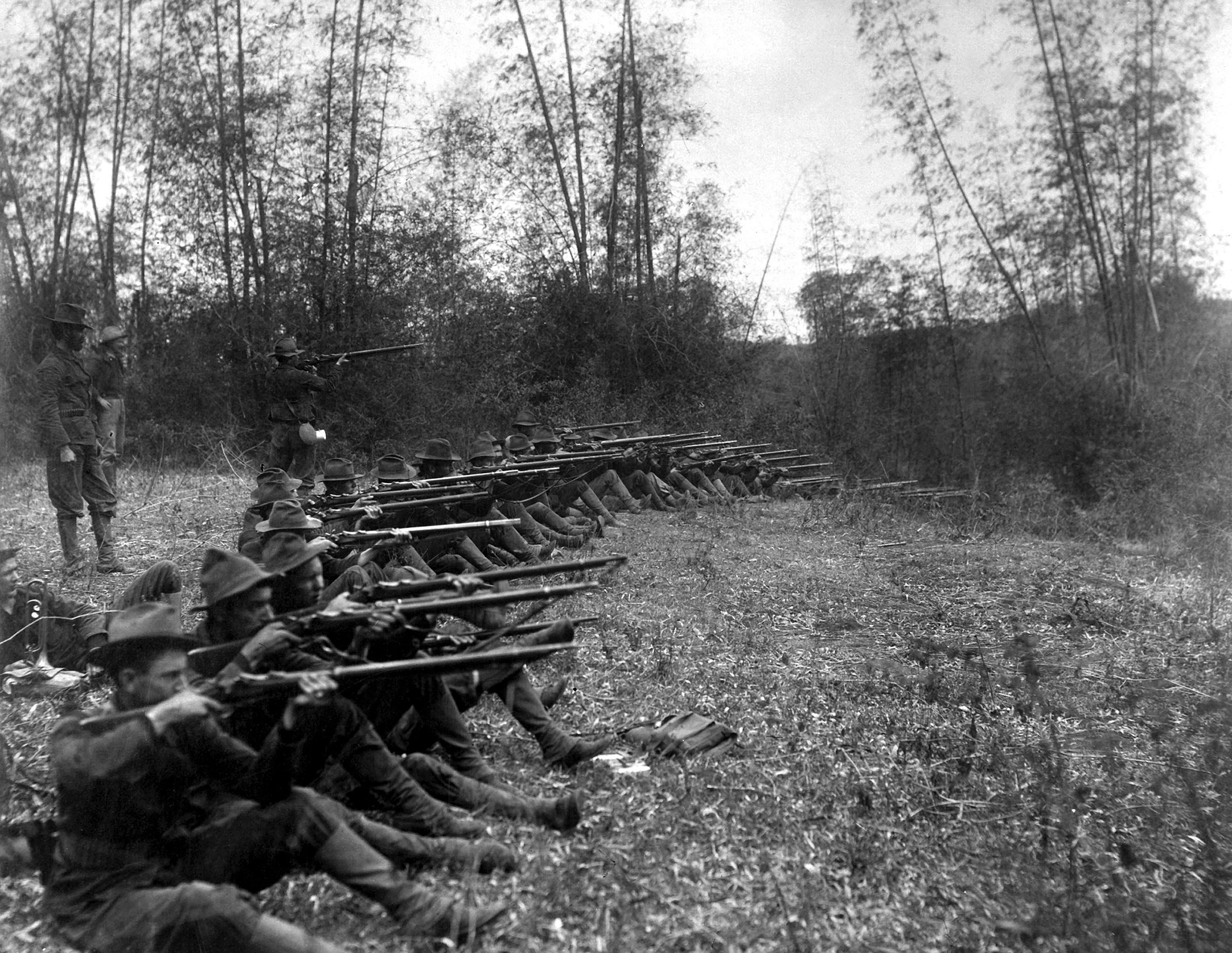 Oregon Volunteer Infantry shooting while on the firing line, in the vicinity of Pasig, in the Philippines, during the Philippine-American War, March 1899.