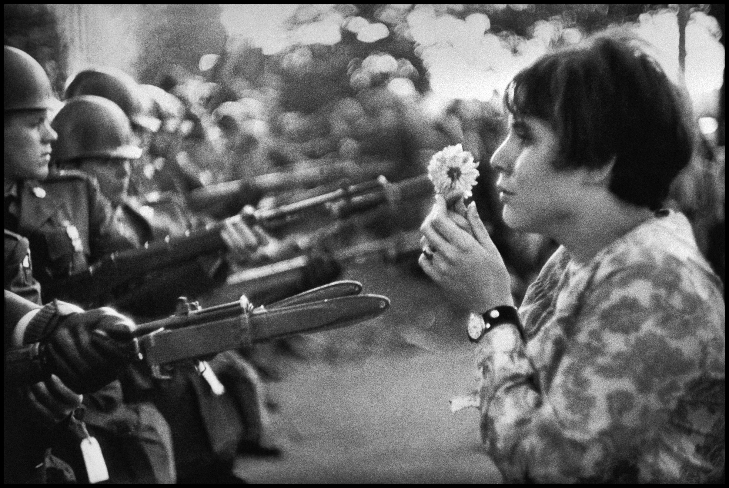 An American young girl, Jan Rose KASMIR, confronts the American National Guard outside the Pentagon during the 1967 anti-Vietnam march. This march helped to turn public opinion against the US war in Vietnam. Washington, D.C., 1967.