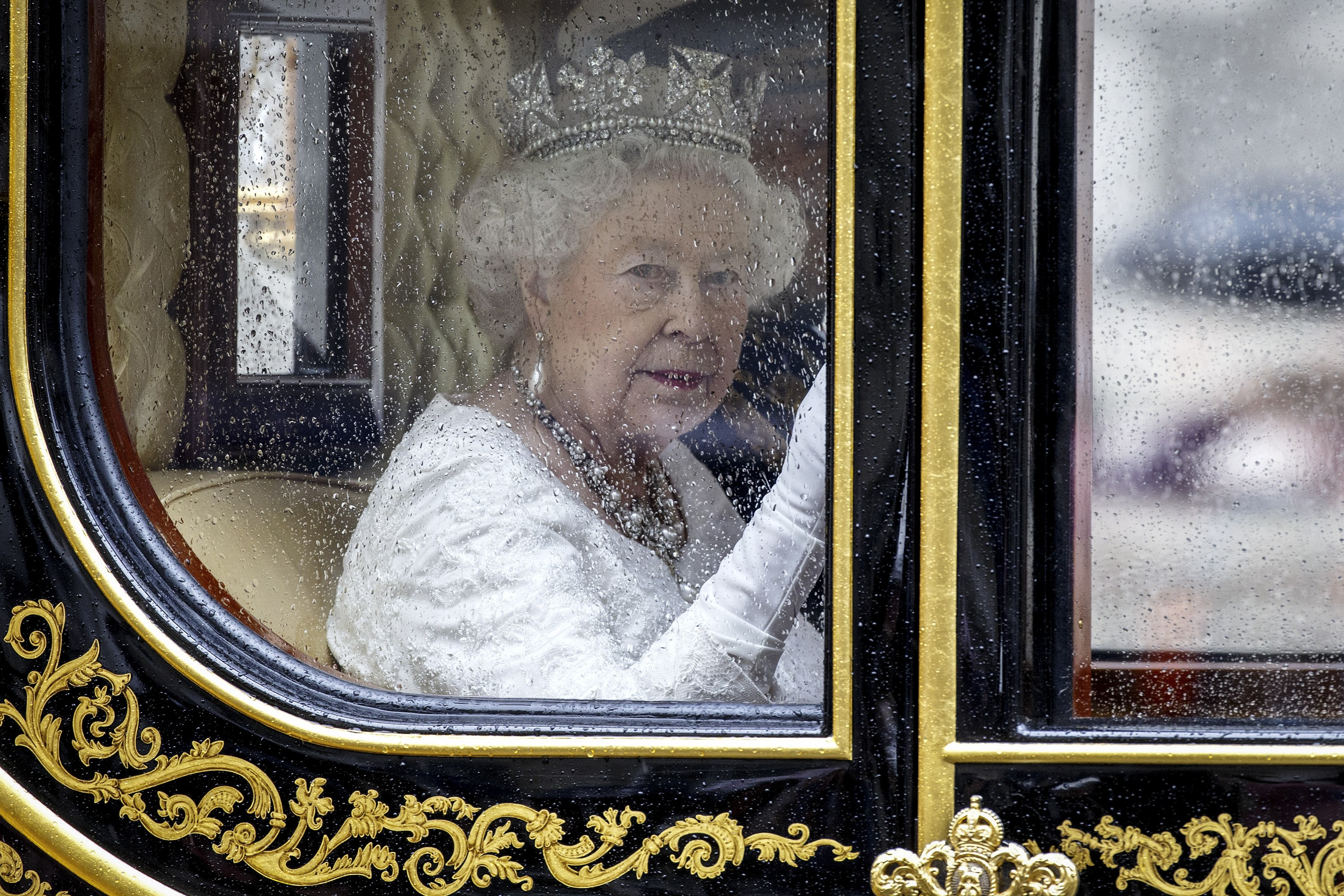 Britain's Queen Elizabeth II travels from the Houses of Parliament to Buckingham Palace after the Queen addressed the State Opening of Parliament in London, England on May 18, 2016.