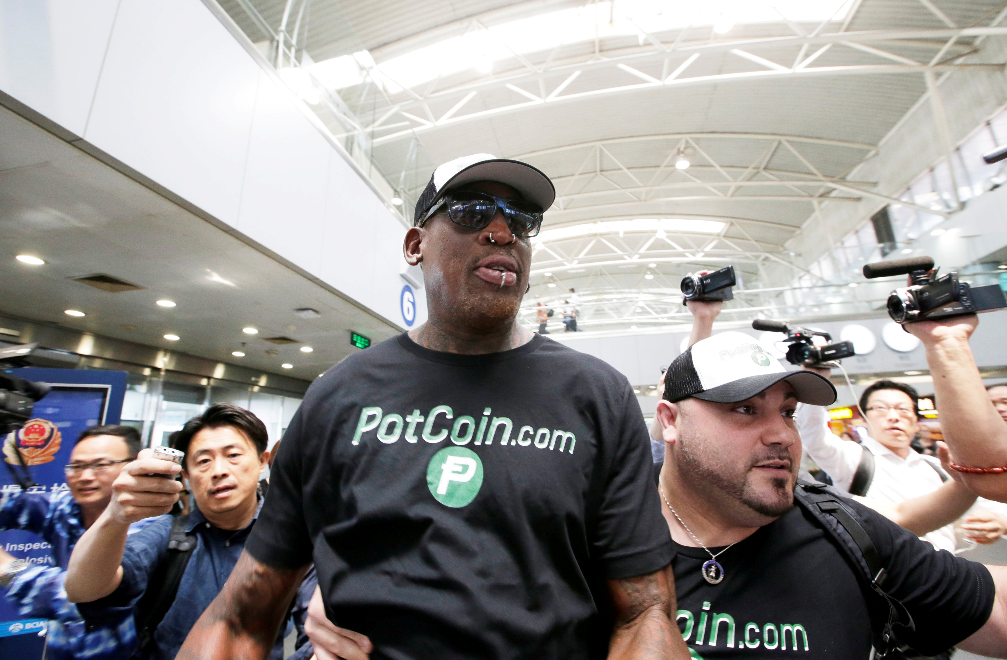 Former NBA basketball player Dennis Rodman arrives at Beijing Capital International Airport as he leaves for North Korea's Pyongyang, in Beijing, China, June 13, 2017.