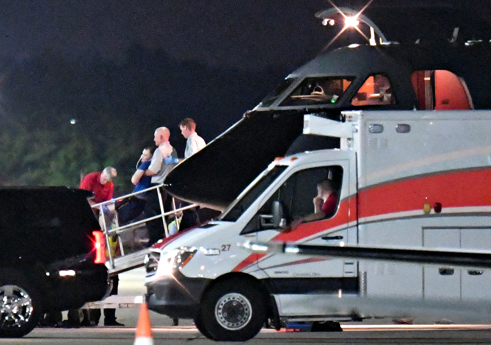 A person believed to be Otto Warmbier is transferred from a medical transport airplane to an awaiting ambulance at Lunken Airport in Cincinnati, Ohio, June 13, 2017.