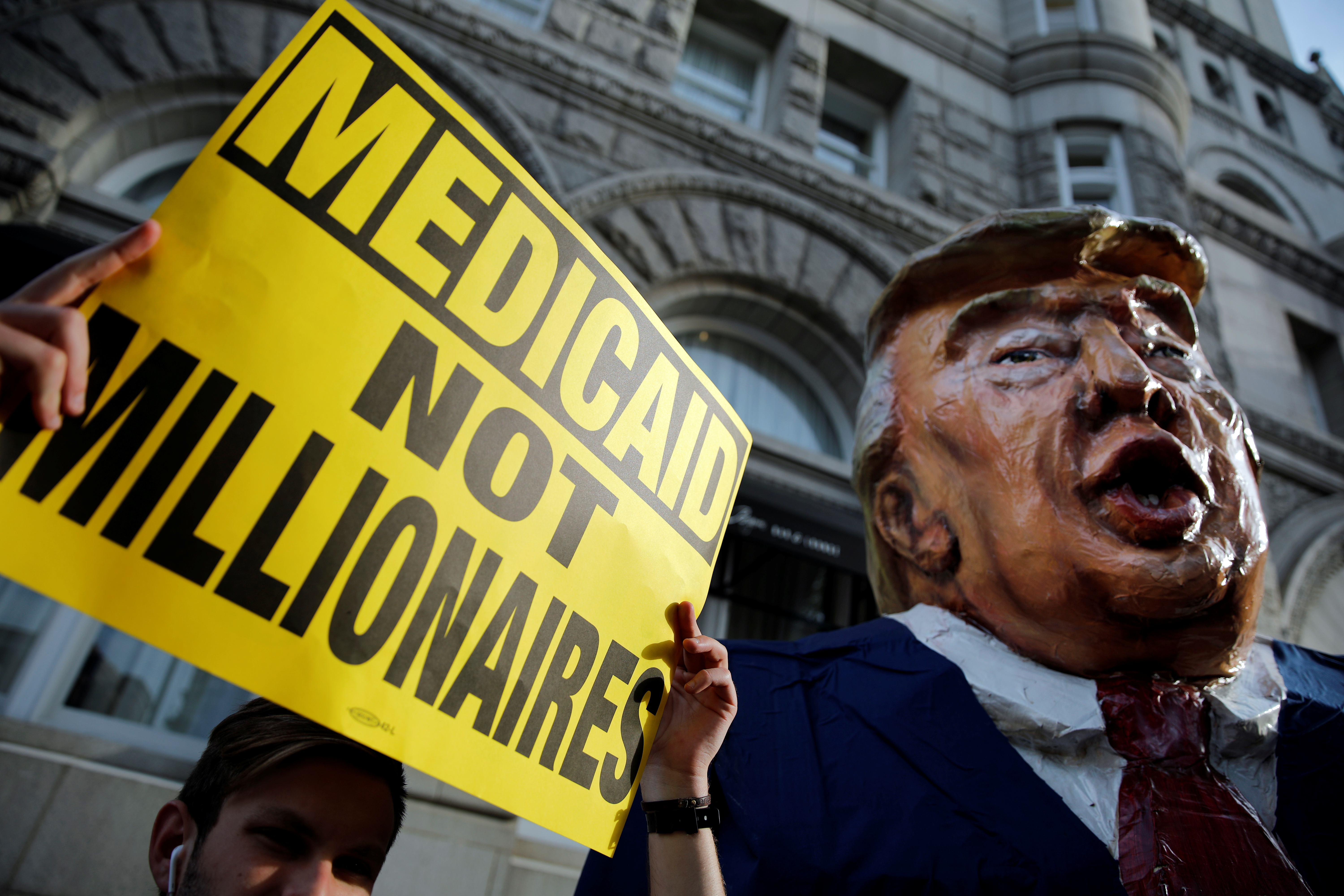 A puppet of U.S. President Donald Trump is seen as protesters gather outside Trump International Hotel in downtown Washington on June 28, 2017.