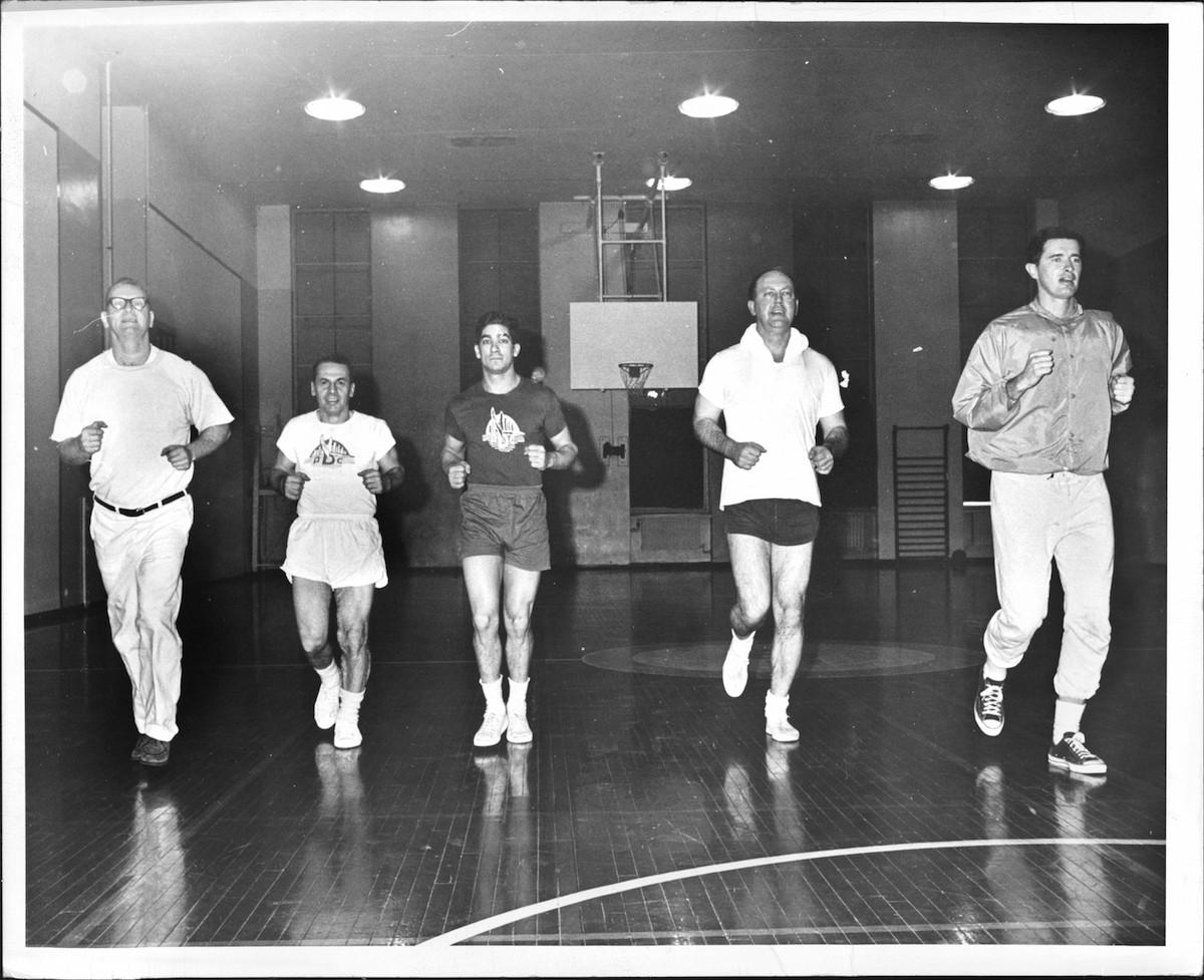 Businessmen jogging in New York in 1968