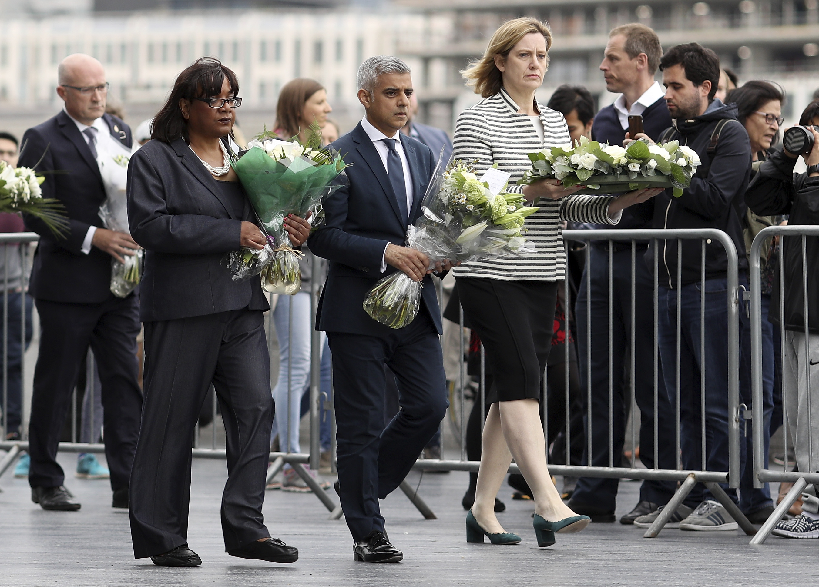 (L-R) Shadow Home Secretary Diane Abbott, Mayor of London Sadiq Khan and Home Secretary Amber Rudd take part in a vigil for the victims of the London Bridge terror attacks, in Potters Fields Park on June 5, 2017 in London, England. Seven people were killed and at least 48 injured in terror attacks on London Bridge and Borough Market on June 3rd. Three attackers were shot dead by armed police.