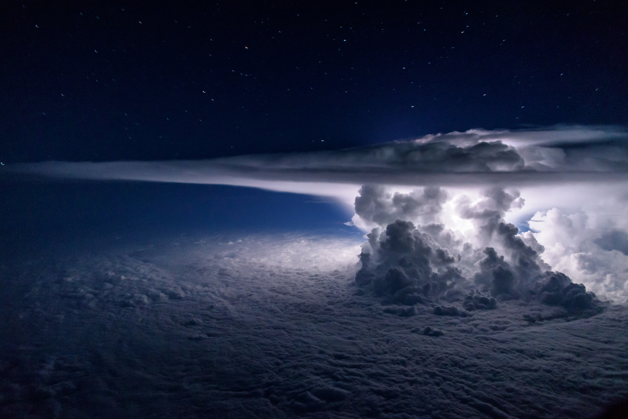 Colossal cumulonimbus clouds over the Pacific Ocean south of Panama City at 37,000 feet.