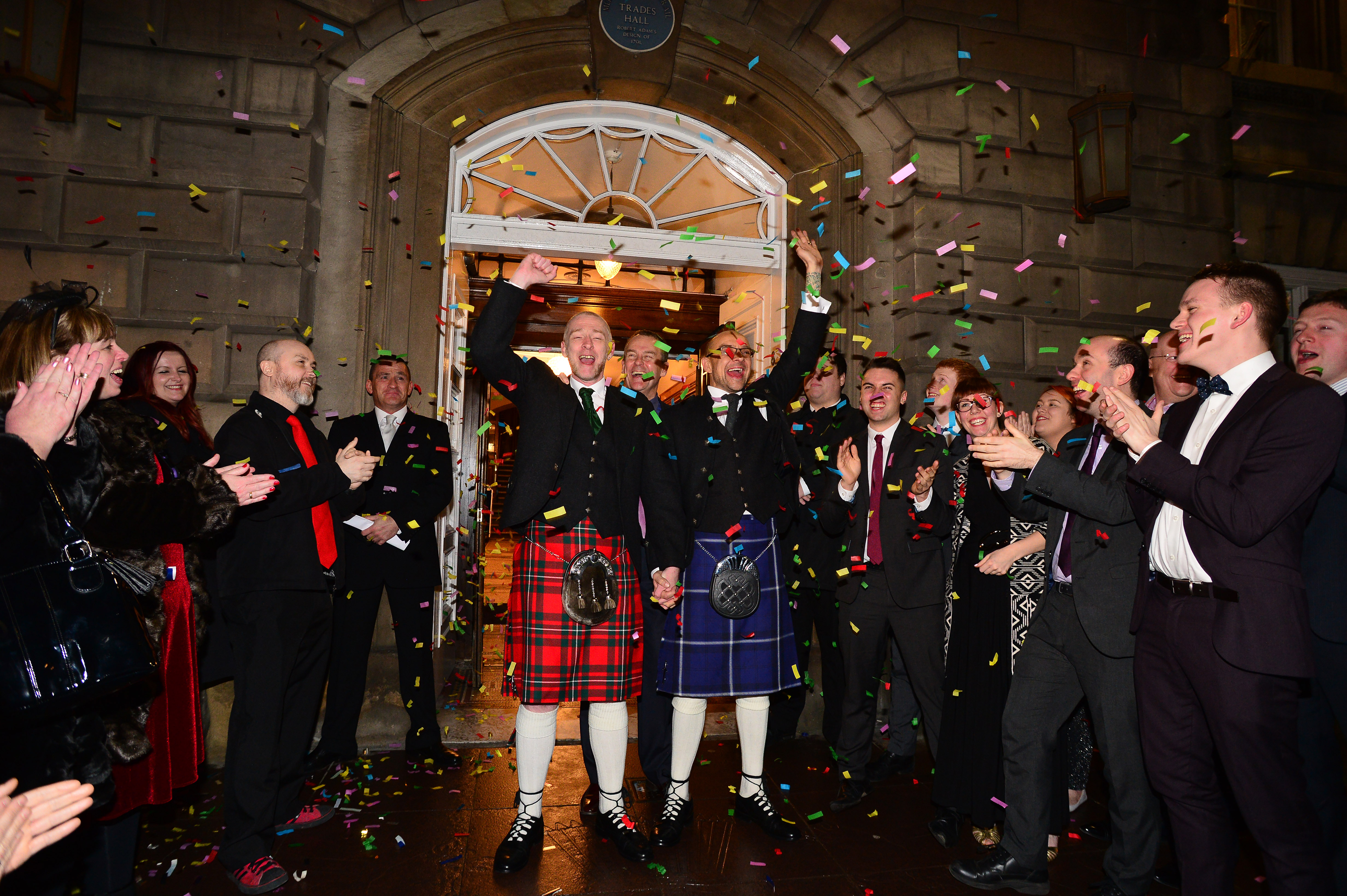 A same-sex couple Joe Schofield (blue kilt) and Malcolm Brown from Tullibody, Clackmannanshire are married shortly after midnight in front of friends and family in one of the first same-sex and belief category weddings in Scotland on Dec. 31, 2014 in Glasgow, Scotland.