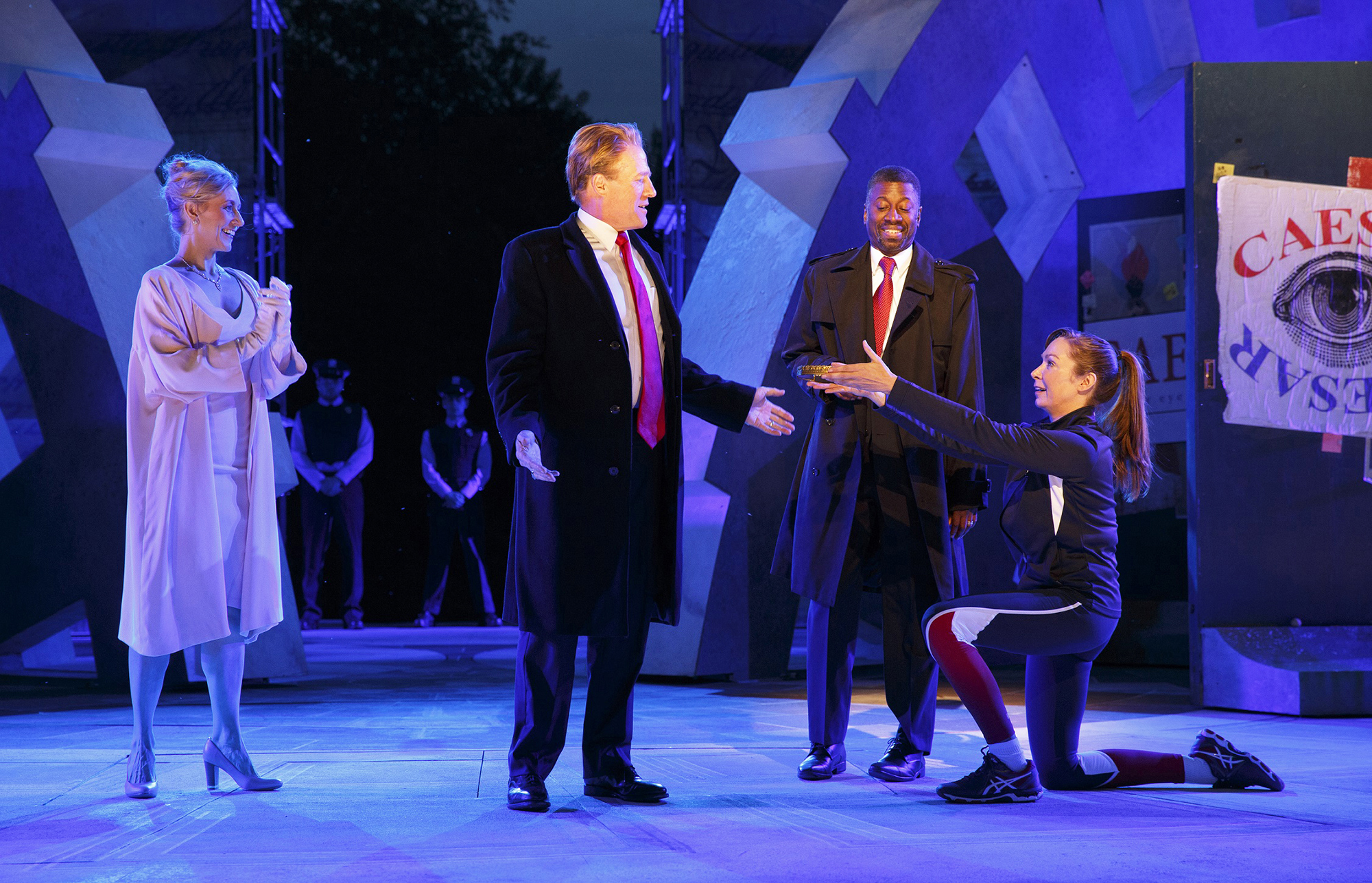 Tina Benko, left, portrays Melania Trump in the role of Caesar's wife, Calpurnia, and Gregg Henry, center left, portrays President Donald Trump in the role of Julius Caesar during a dress rehearsal of The Public Theater's Free Shakespeare in the Park production of Julius Caesar in New York City, on May 21, 2017.