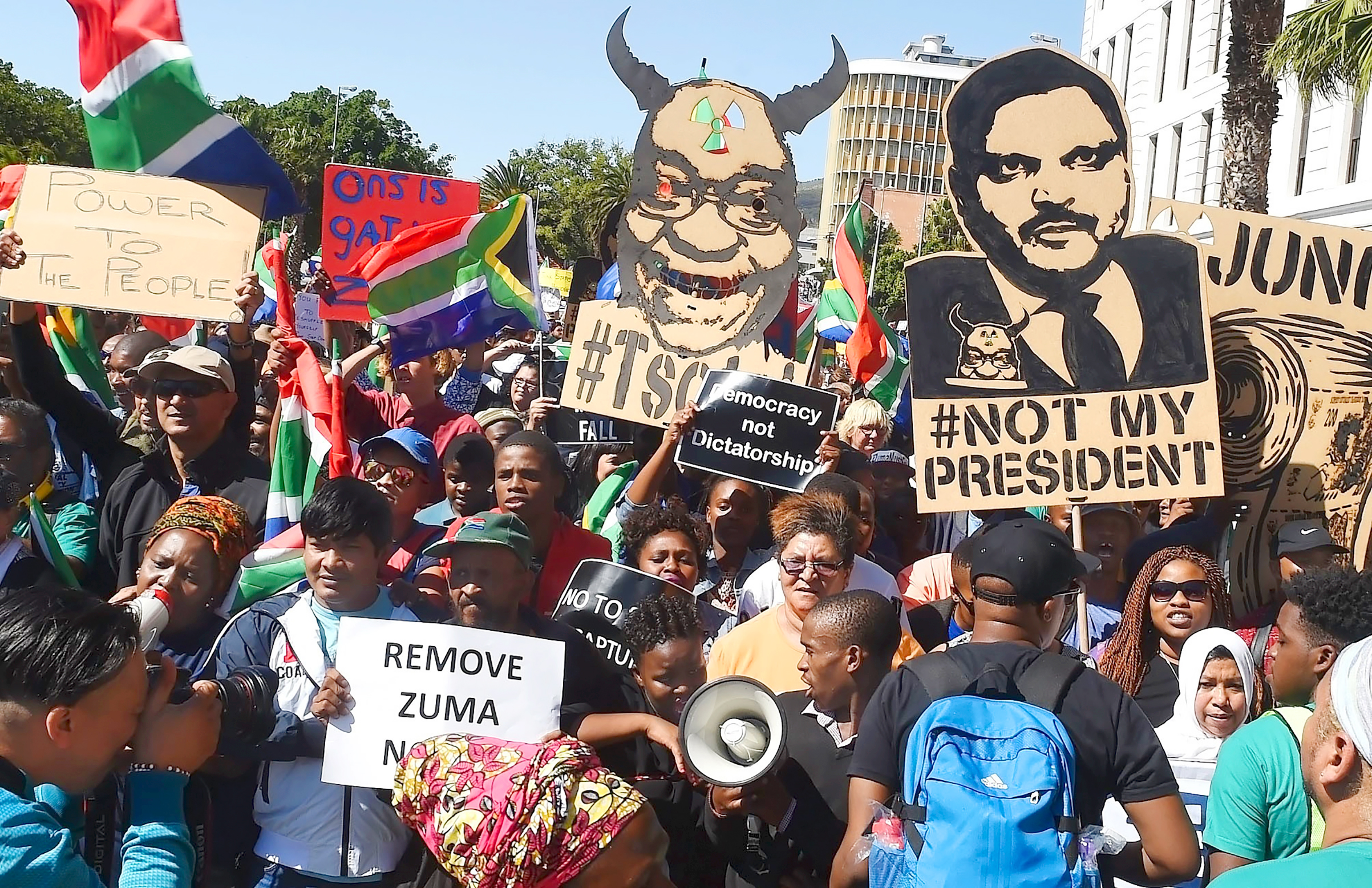 A placard depicting Atul Gupta, right,                      is seen at an anti-Zuma protest in April