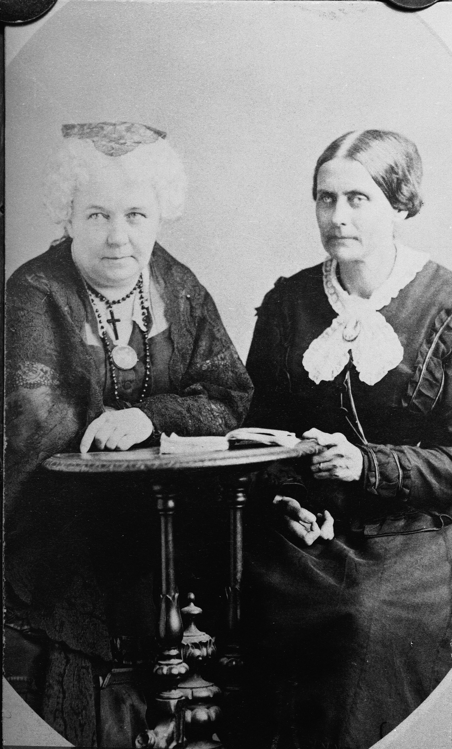 American suffragettes Susan B. Anthony and Elizabeth Cady Stanton sit at a desk together, circa 1890s.
