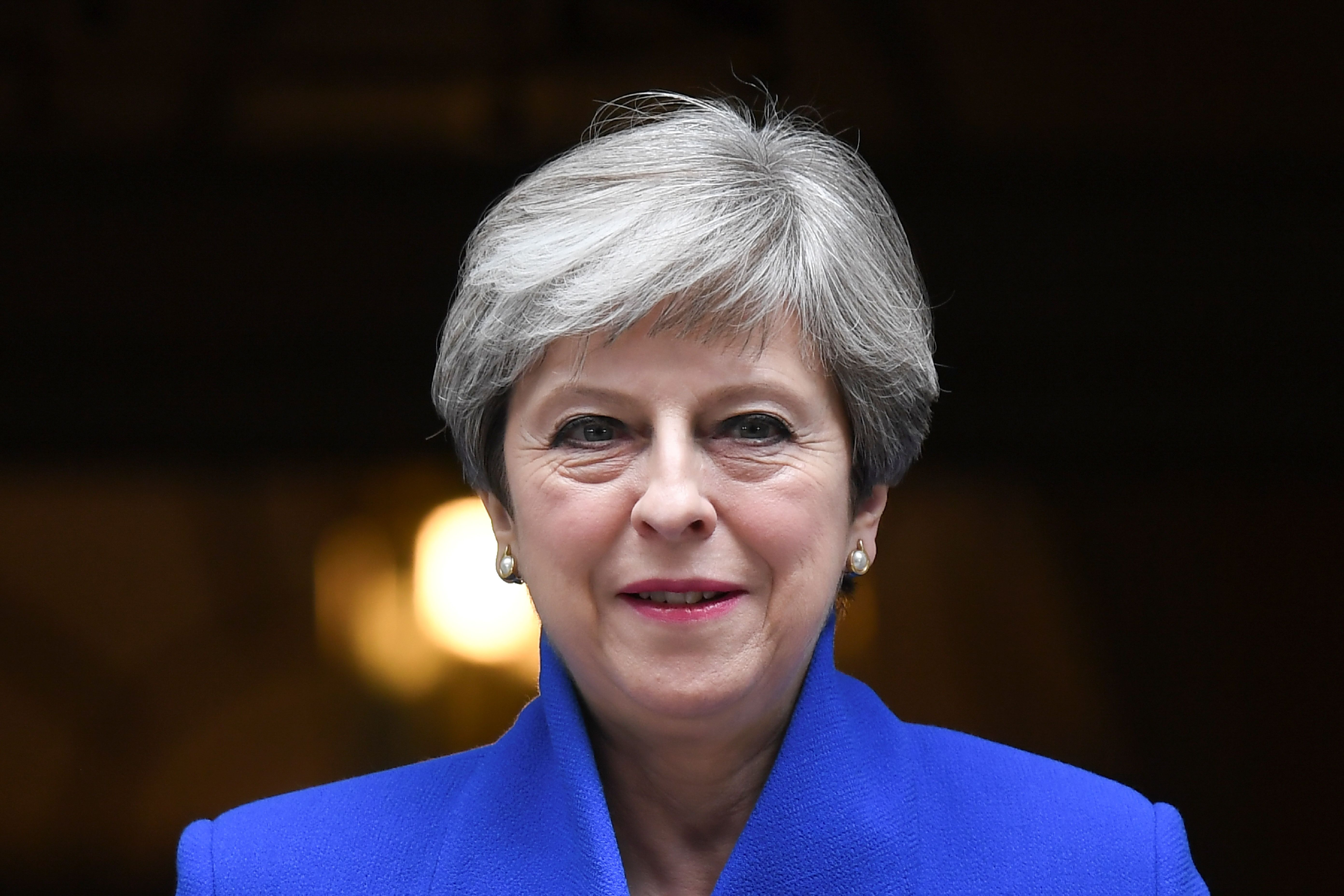 Britain's Prime Minister and leader of the Conservative Party Theresa May leaves 10 Downing Street in London, on June 9, 2017.