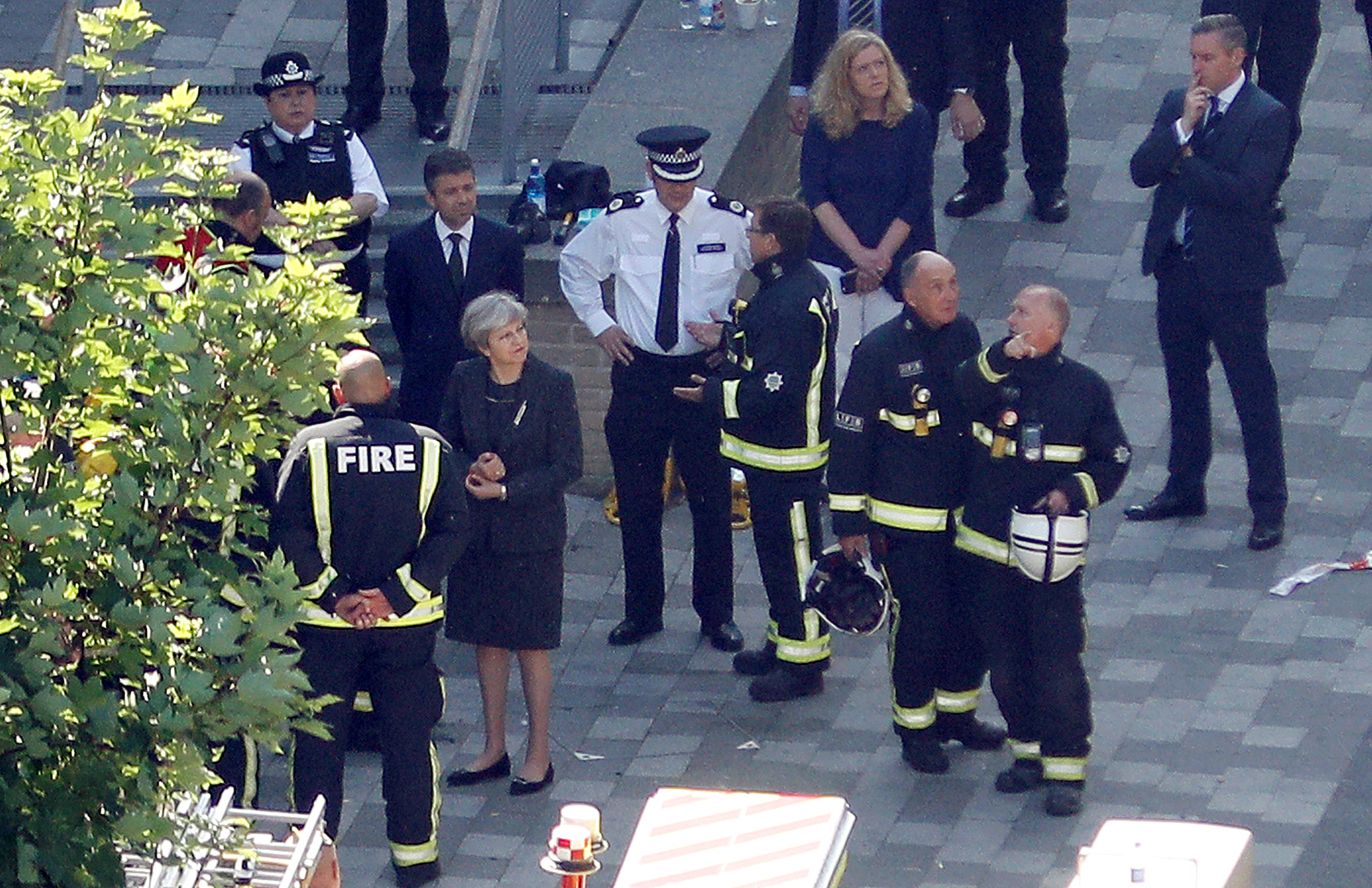 Britain's Prime Minister, Theresa May, visits the scene of a tower block which was destroyed in a fire disaster, in north Kensington, West London, June 15, 2017.