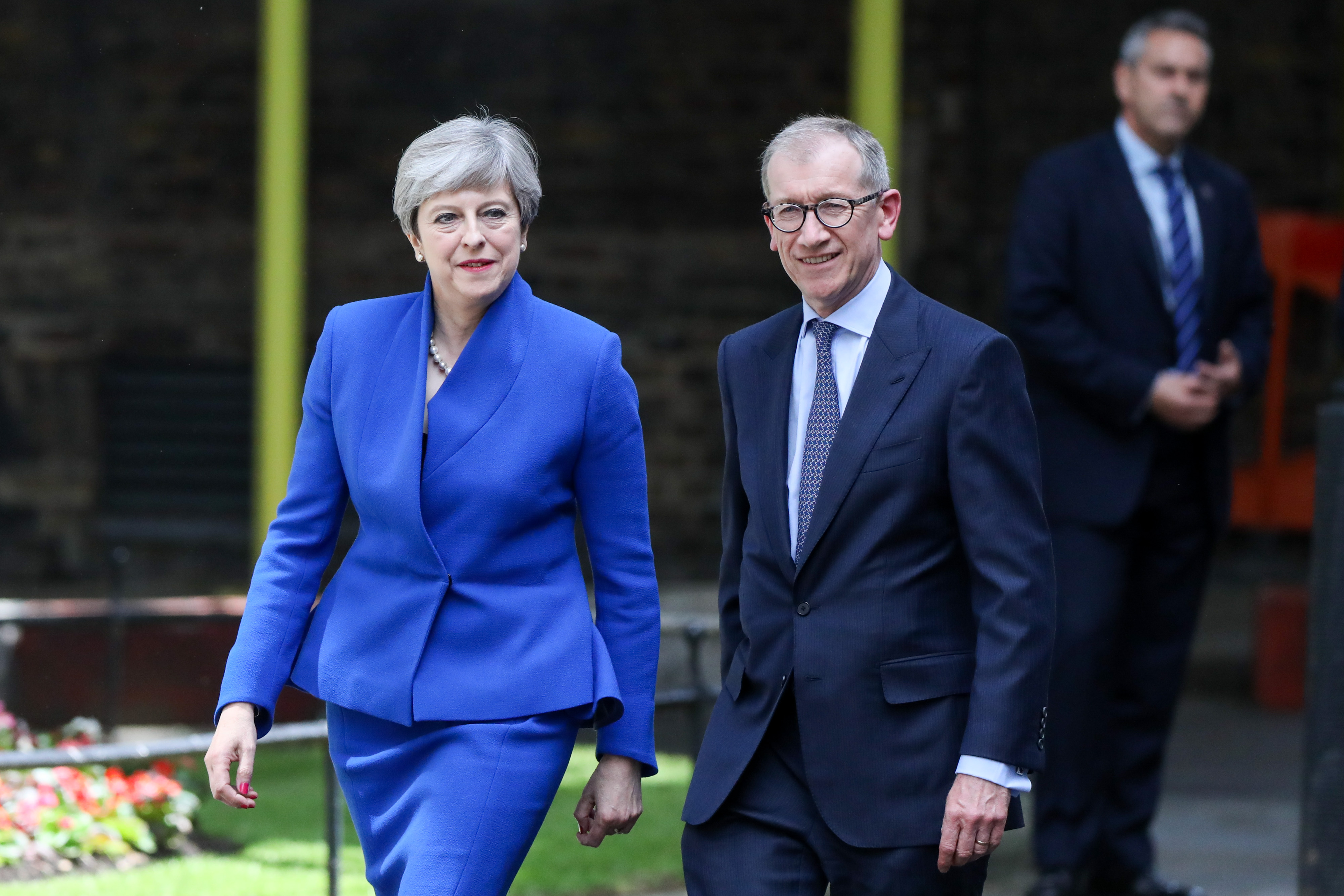 Theresa May and her husband Philip May return to number 10 Downing Street after meeting Queen Elizabeth II, in London, on June 9, 2017.