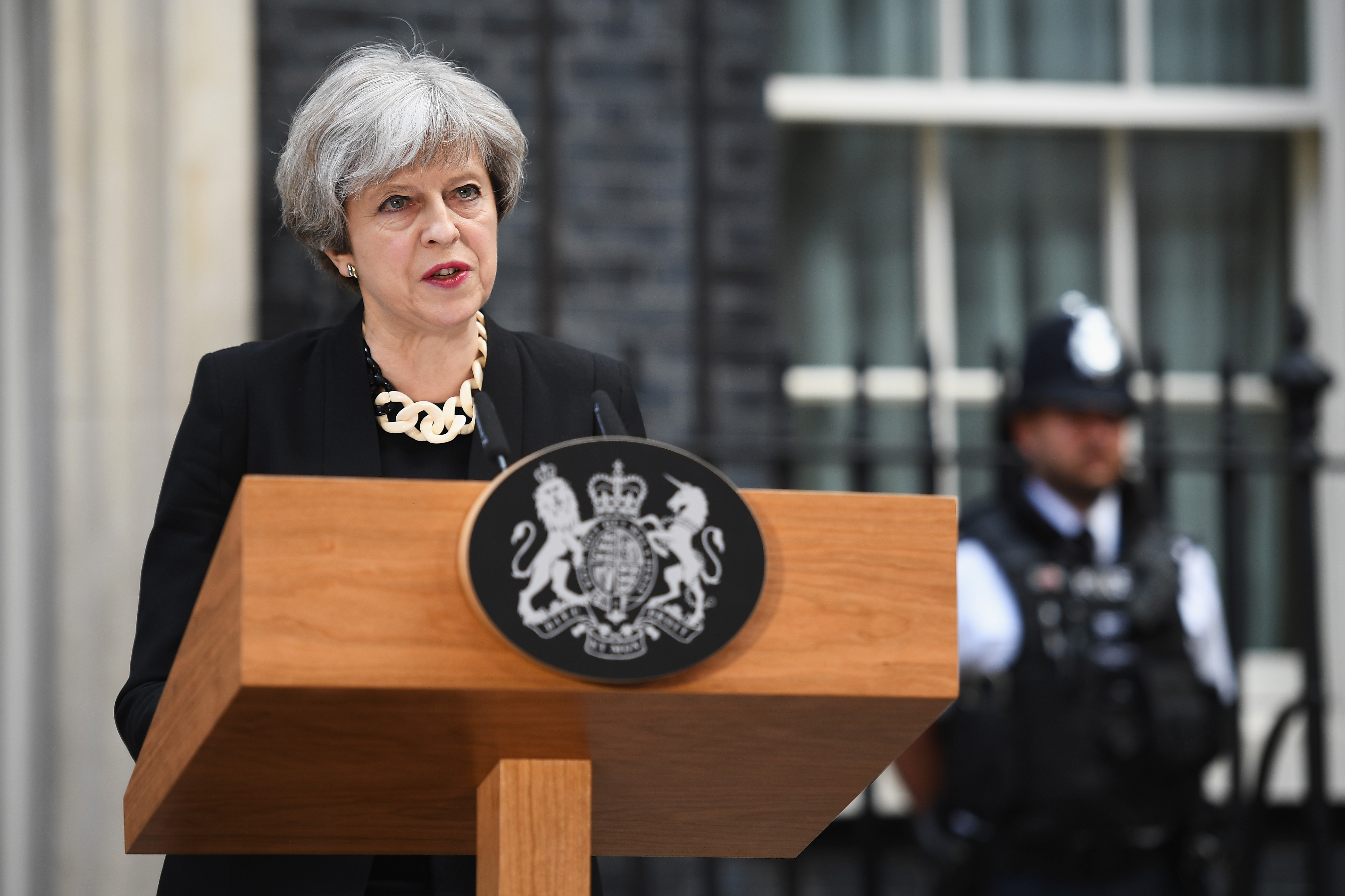 Britain's Prime Minister Theresa May addresses the media as she makes a statement, following a COBRA meeting in response to last night's London terror attack, at 10 Downing Street on June 4, 2017 in London, England.