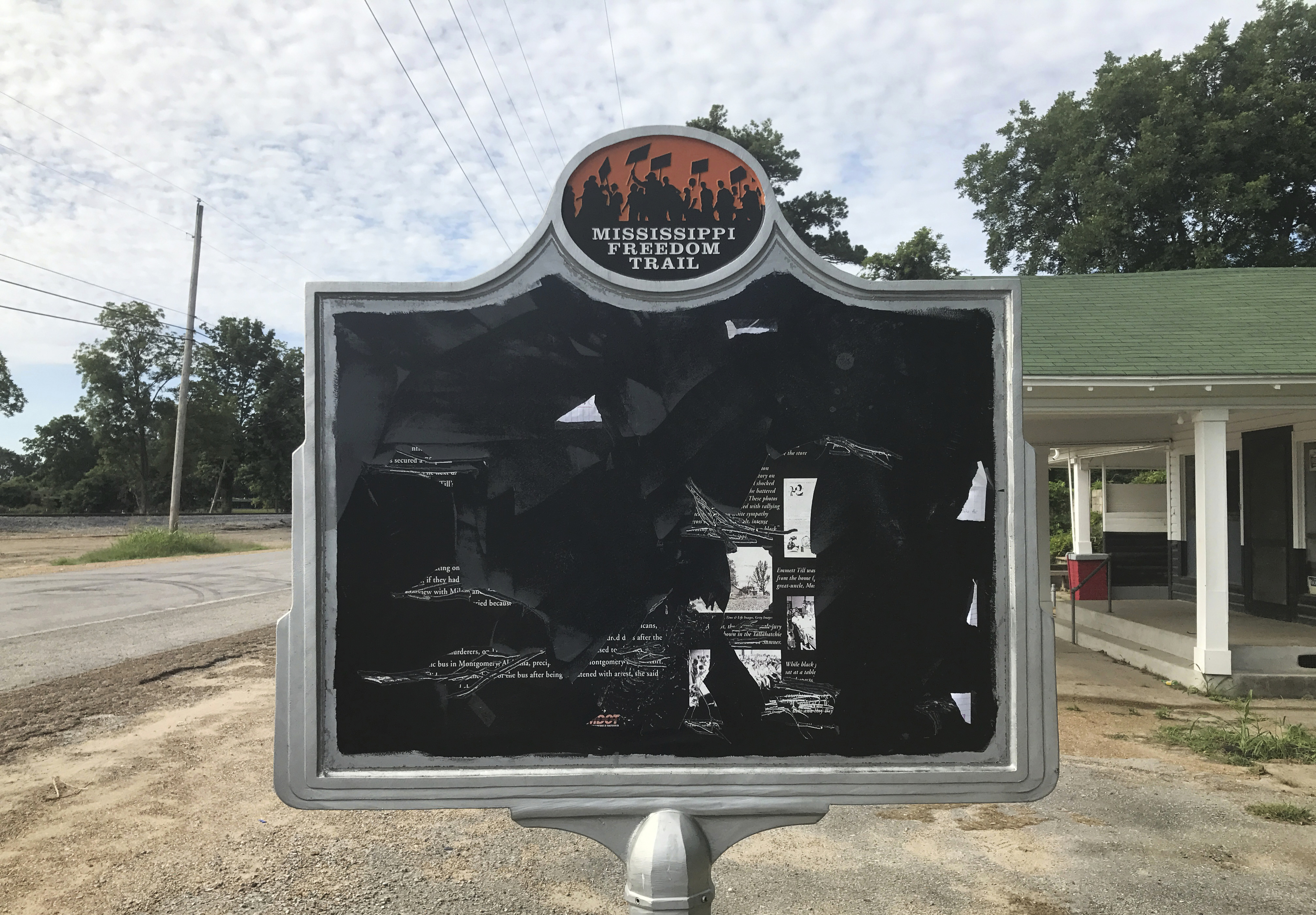 A civil rights historical marker remembers black teenager Emmett Till, who was kidnapped before being lynched in 1955. Allan Hammons, whose public relations firm made the marker, said Monday that someone scratched the marker with a blunt tool.