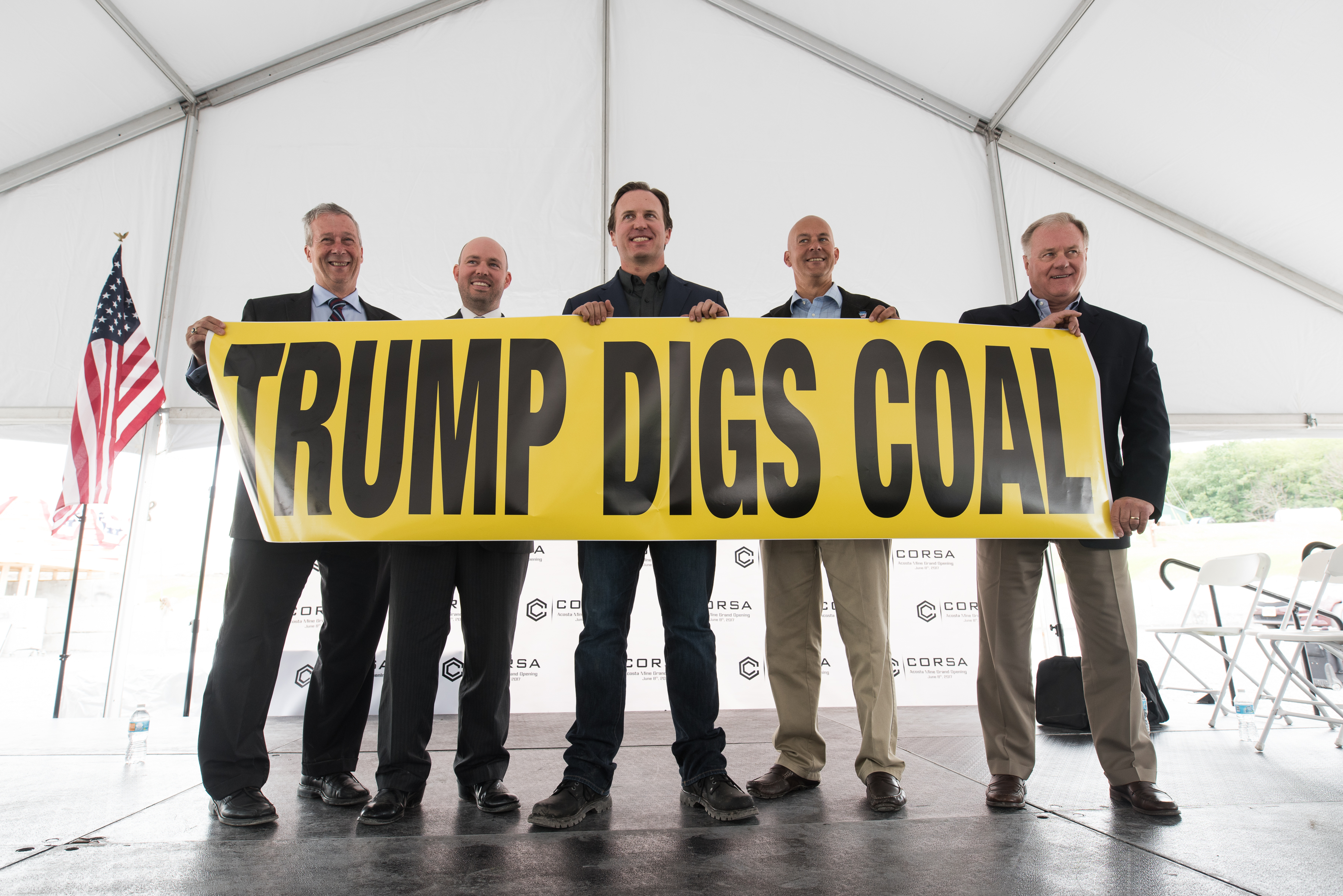 Ron Aldom, executive director of the Somerset County Chamber of Commerce, Carl Metzgar, PA State Representative, George Dethlefsen, CEO Corsa Coal Corp., Pat Stefano, PA State Senator, and Scott Wagner, PA State Senator hold up a  Trump Digs Coal  sign at the grand opening of Corsa Coal's Acosta Deep Mine on June 8 in Pennsylvania.