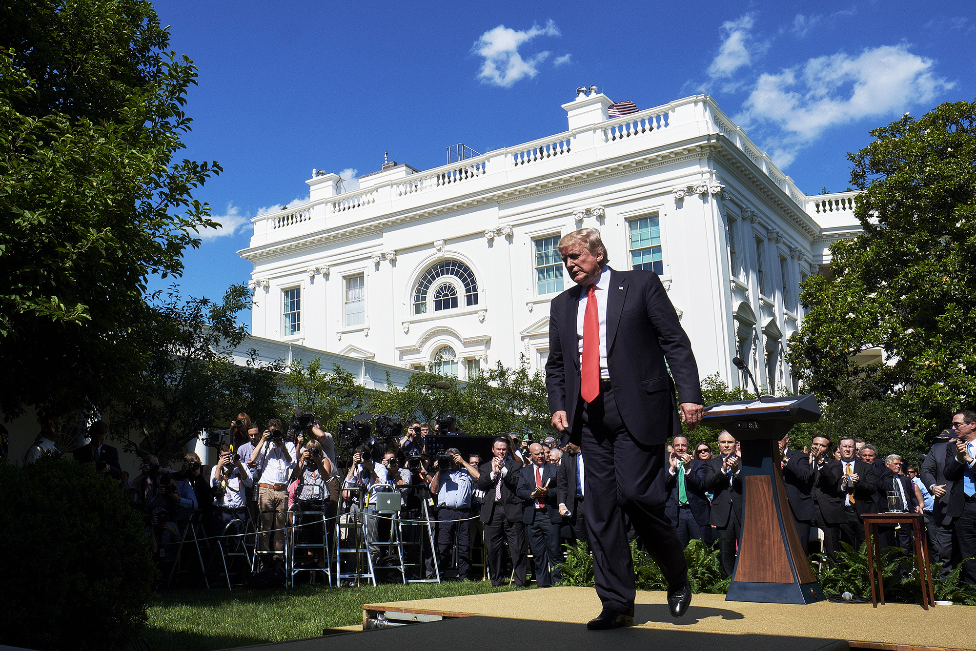 Donald Trump exits following an announcement in the Rose Garden of the White House that the U.S. would leave the Paris climate pact in Washington, D.C., U.S., on June 1, 2017.