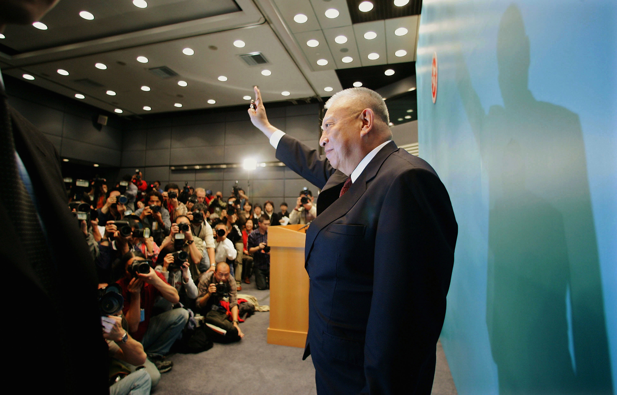 Hong Kong's first Chief Executive Tung Chee-hwa leaves a news conference after announcing his resignation on March 10, 2005. Tung cited health reasons for cutting short what was to have been an eight-year tenure. His administration was plagued by economic recession, policy blunders and unease over China's interference.