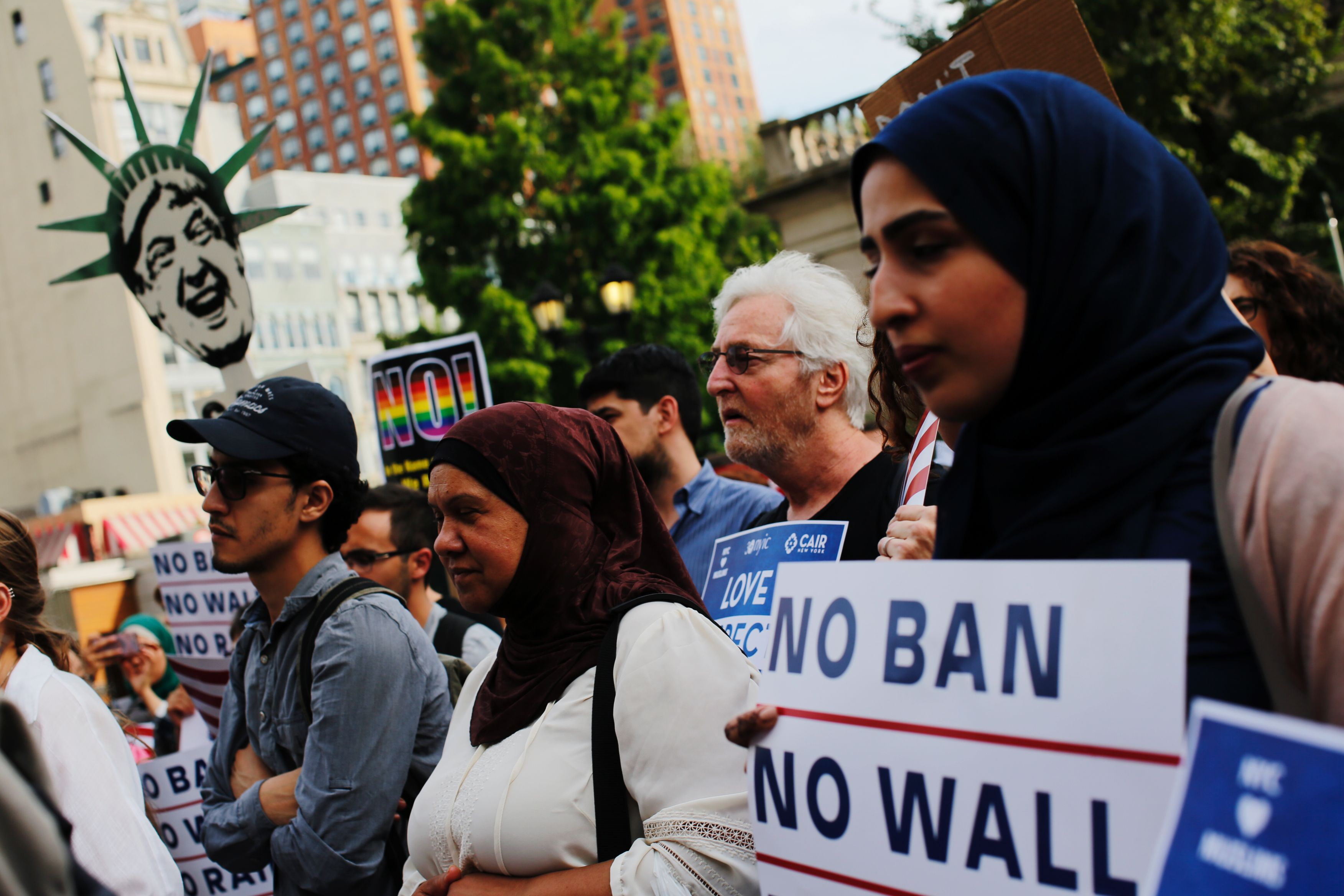 Widad Hassan and other New Yorkers take part in a rally to protest the restrictive guidelines issued by the US on who qualifies as a close familial relationship at Union Square on June 29, 2017, in New York.