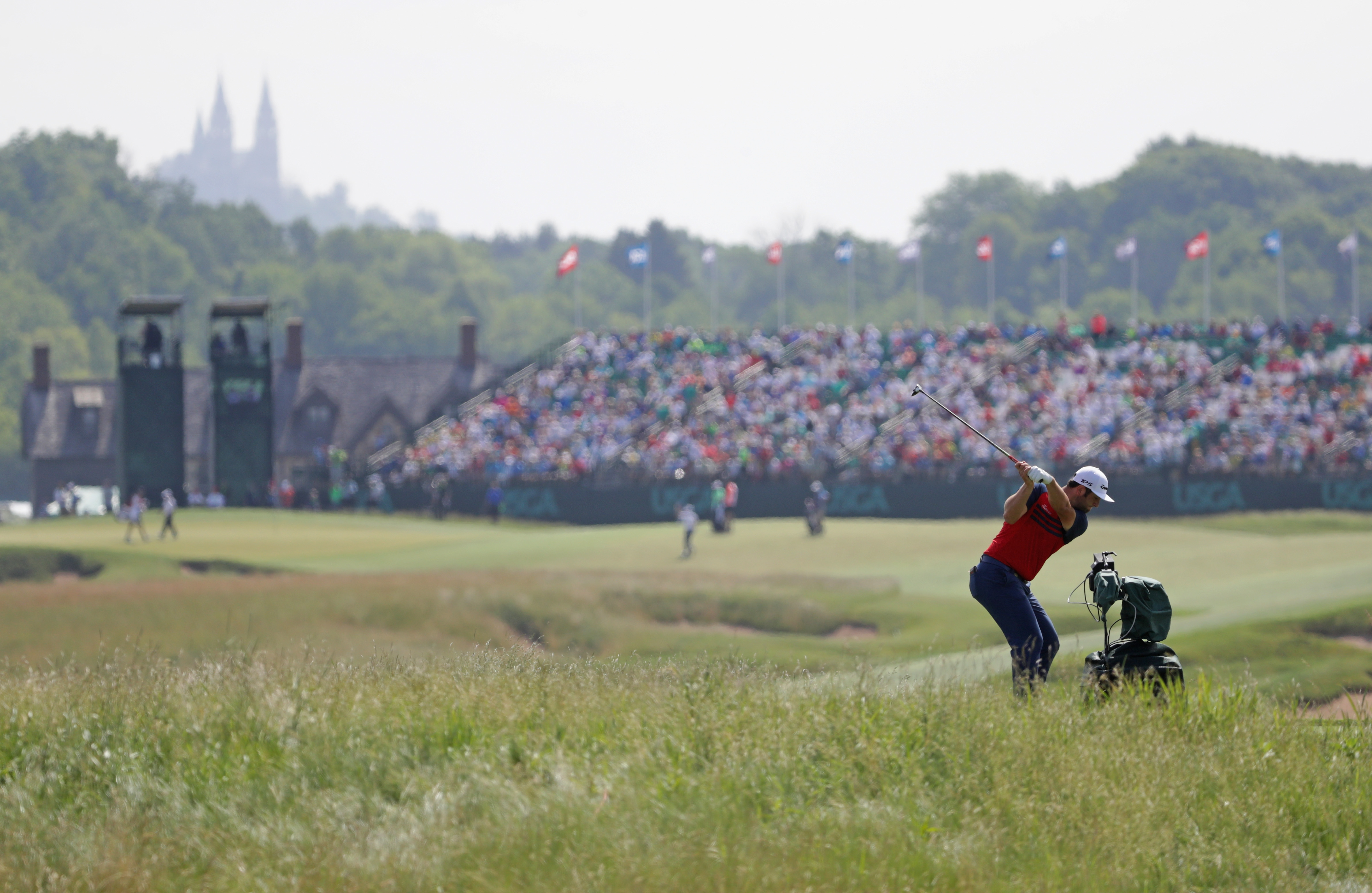 Jon Rahm of Spain plays his shot on the 18th hole during the first round of the 2017 U.S. Open at Erin Hills on June 15, 2017 in Hartford, Wisconsin.