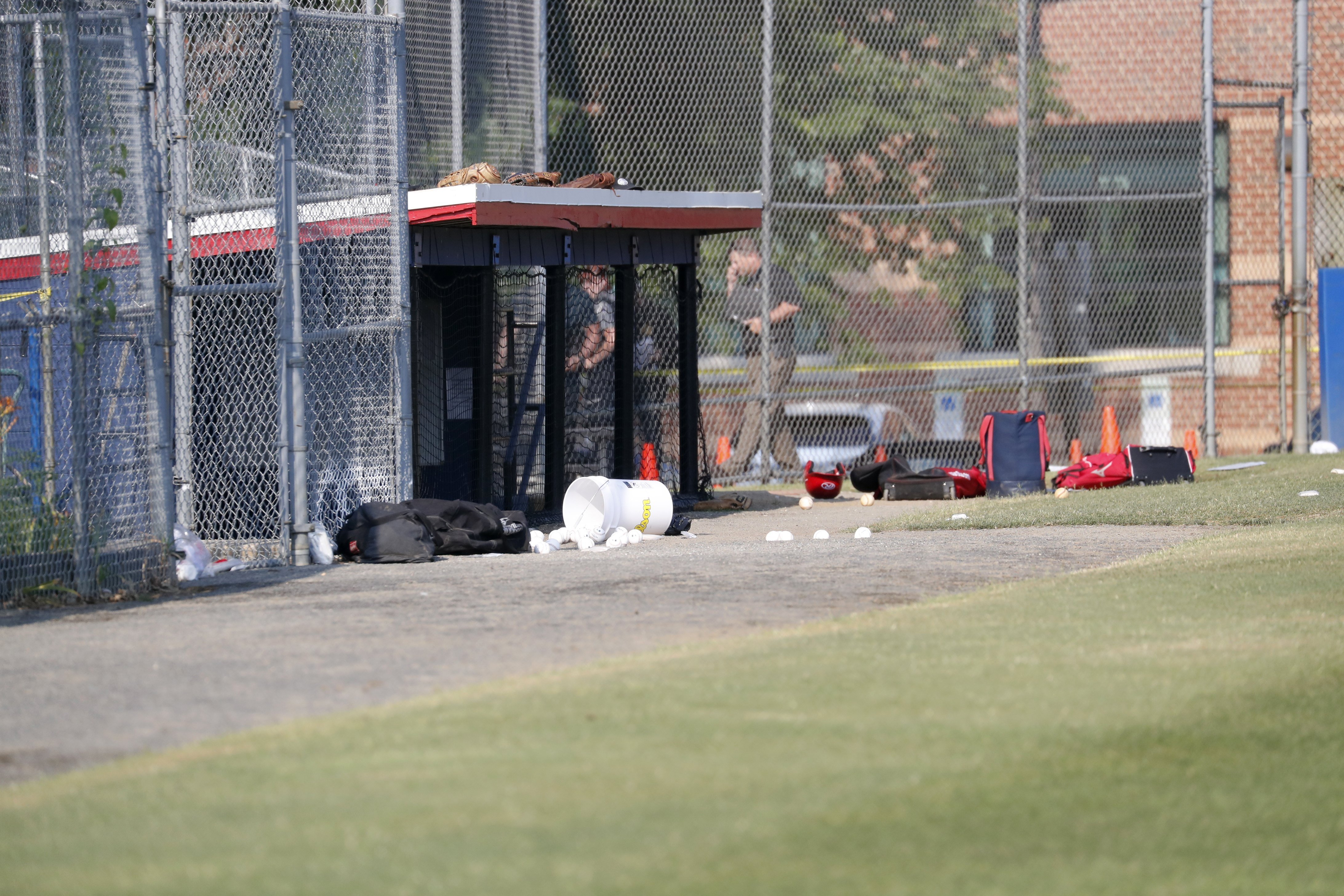 Baseball equipment is seen scattered on the field where a shooting took place at the practice of the Republican congressional baseball team at Eugene Simpson Stadium Park in Alexandria, Virginia on June 14, 2017.