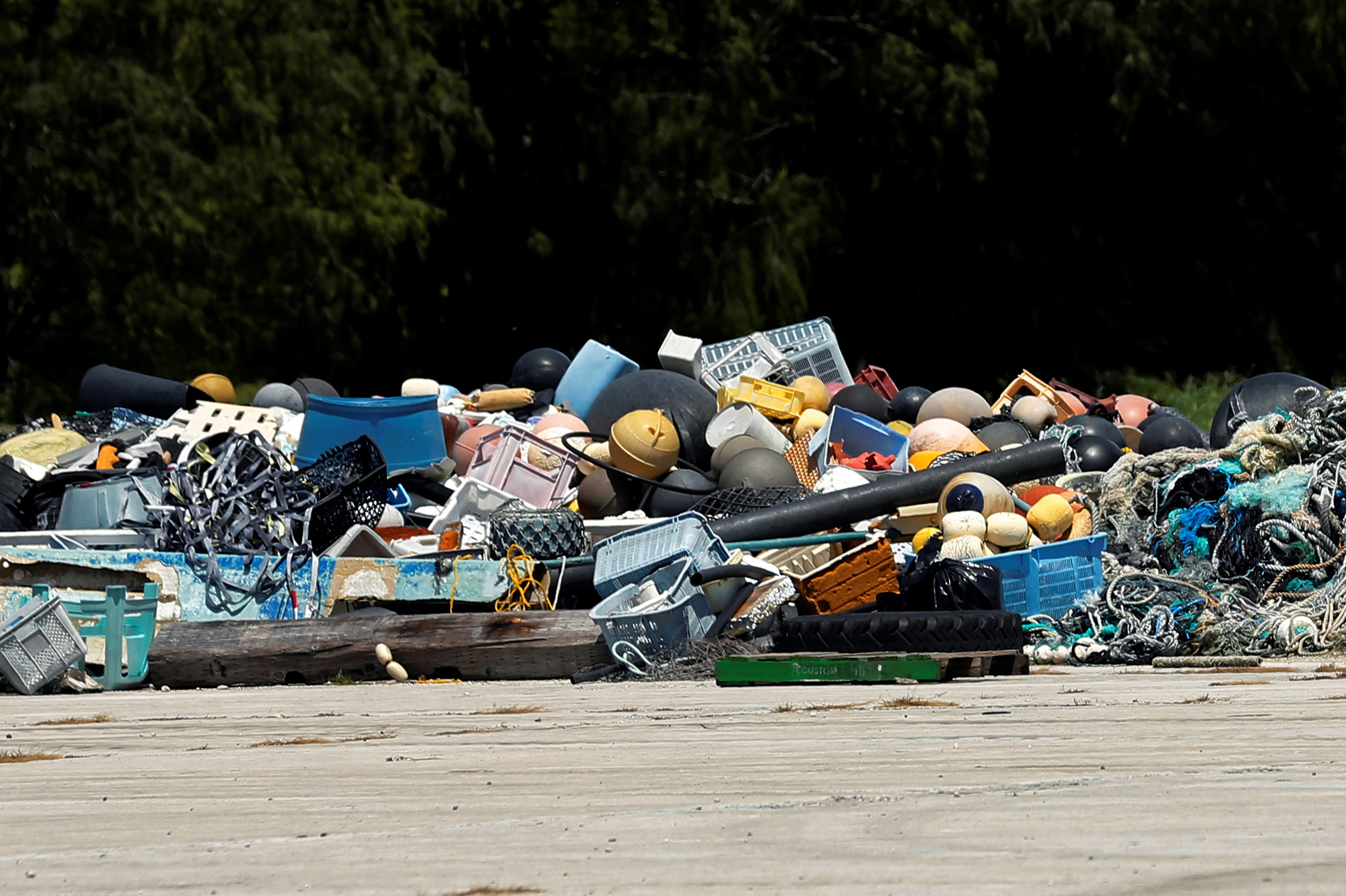 A pile of trash collected after it washed up on shore from the Pacific Ocean, waiting now to be shipped out, is seen as U.S. President Barack Obama tours the trash  boneyard  at Papahanaumokuakea Marine National Monument, Midway Atoll, September 1, 2016.
