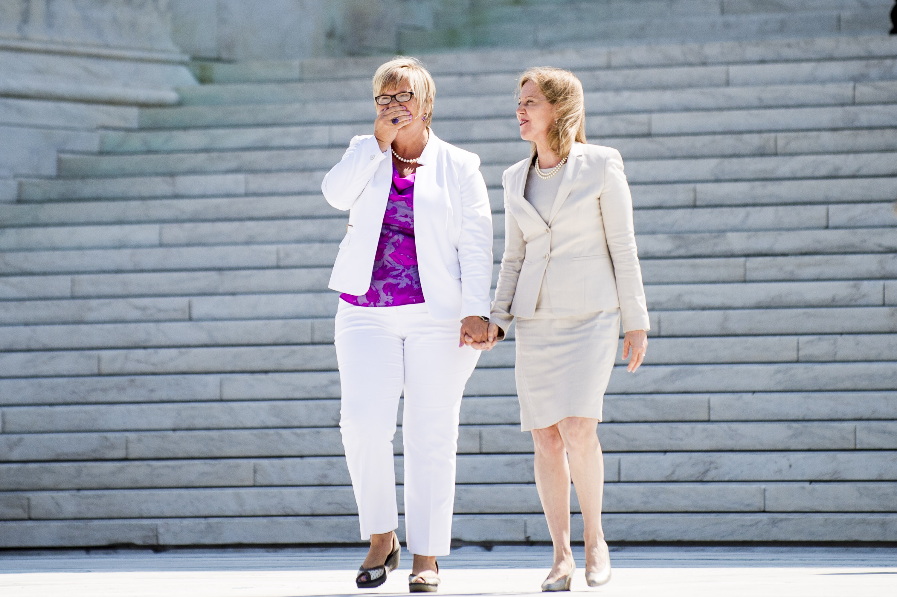 Texas abortion provider Amy Hagstrom-Miller is overcome from the applause as she walks down the steps of the United States Supreme Court with Nancy Northup, President of The Center for Reproductive Rights on June 27, 2016 in Washington, DC.