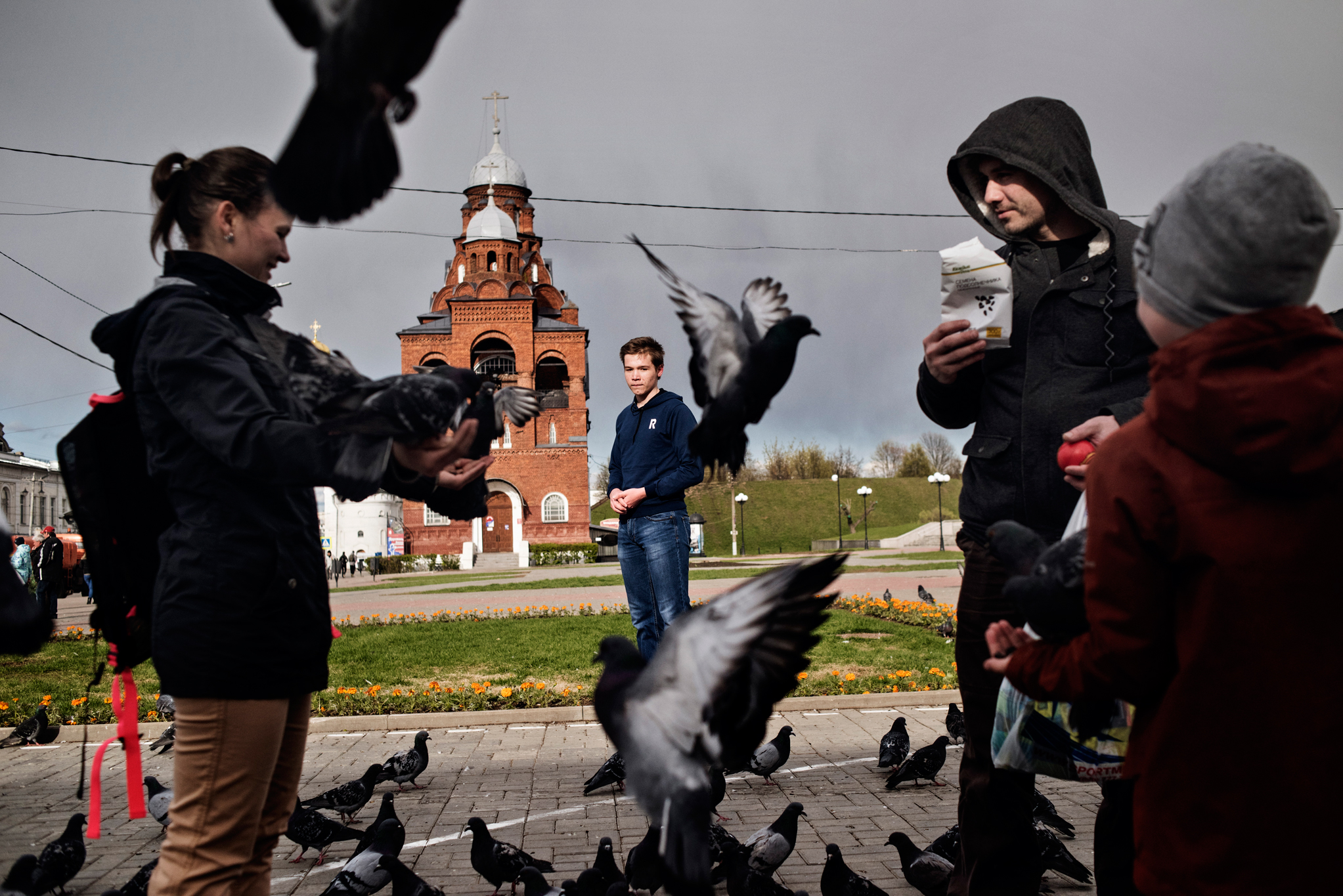 """Born in 2000, the year Russian President Vladimir Putin first came to power, Mikhail (center), represents a generation that Russians have taken to calling """"Putin's Children."""" The speech he gave at an anti-Putin demonstration in March got him in trouble at school in his hometown of Vladimir, Russia. Pictured in May 2017 in Vladimir, he says he still plans to join the next protest, which is scheduled for June 12."""