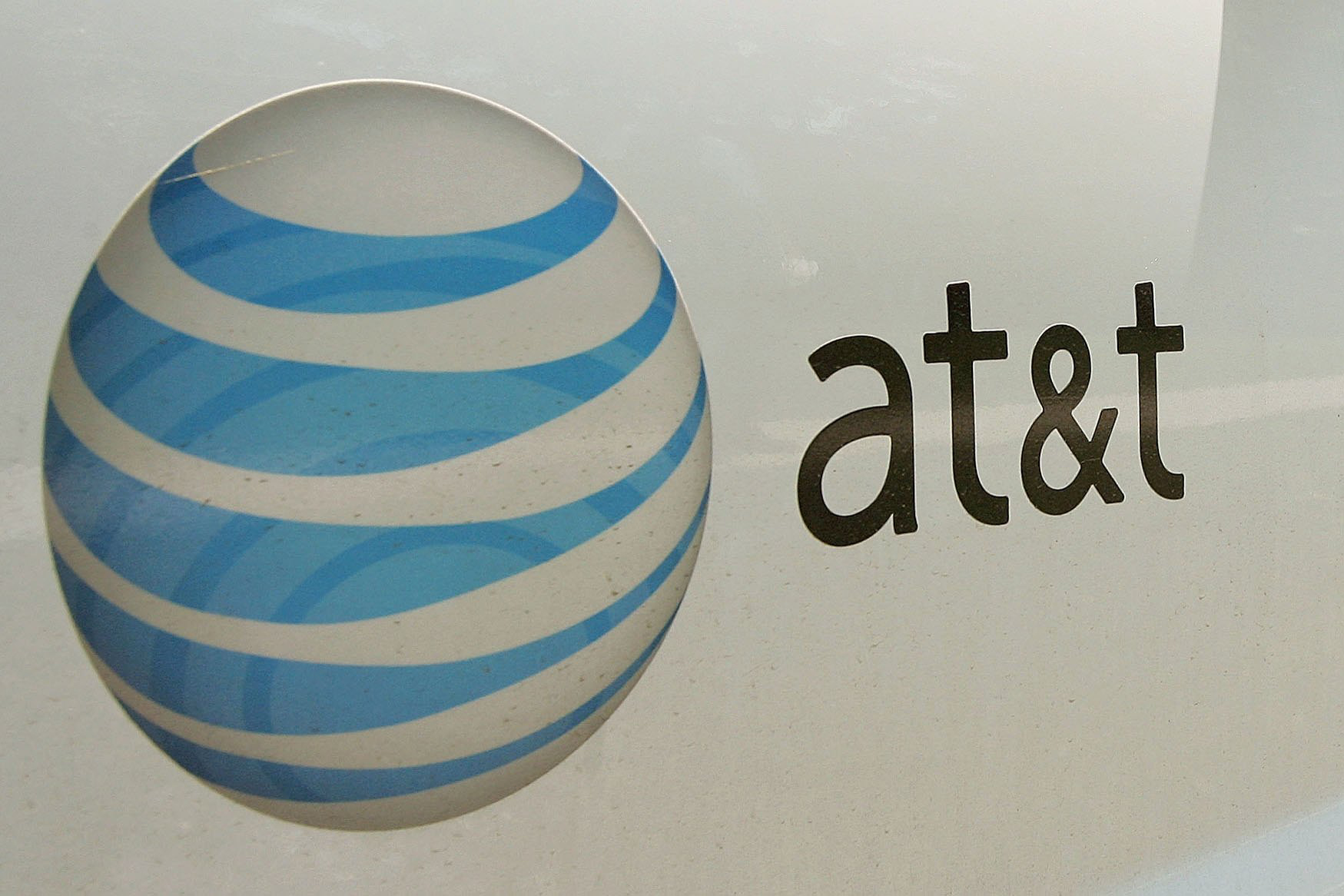 An AT&T logo is displayed on a truck.