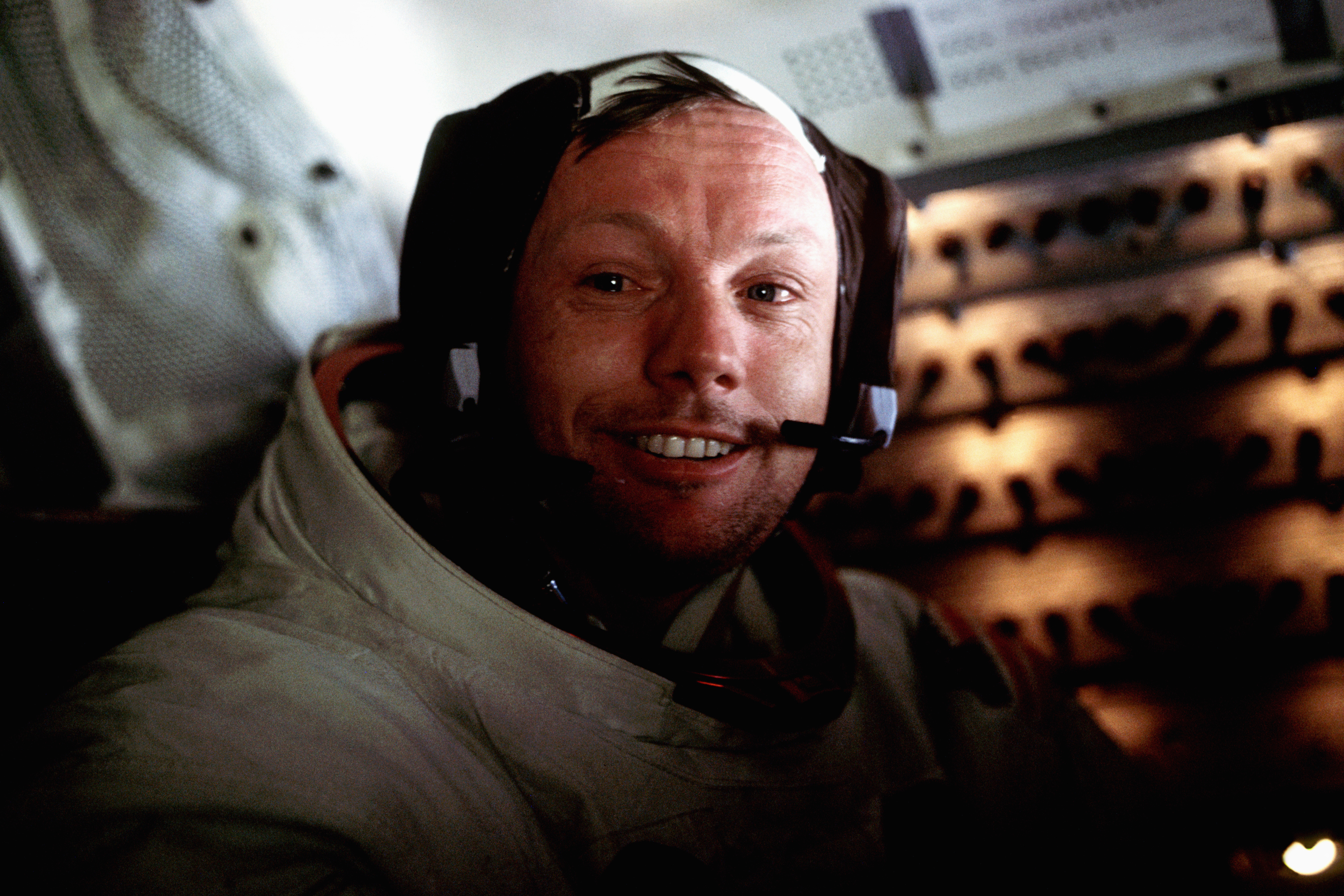 A portrait of Neil Armstrong aboard the Lunar Module Eagle on the lunar surface just after the first moon walk.