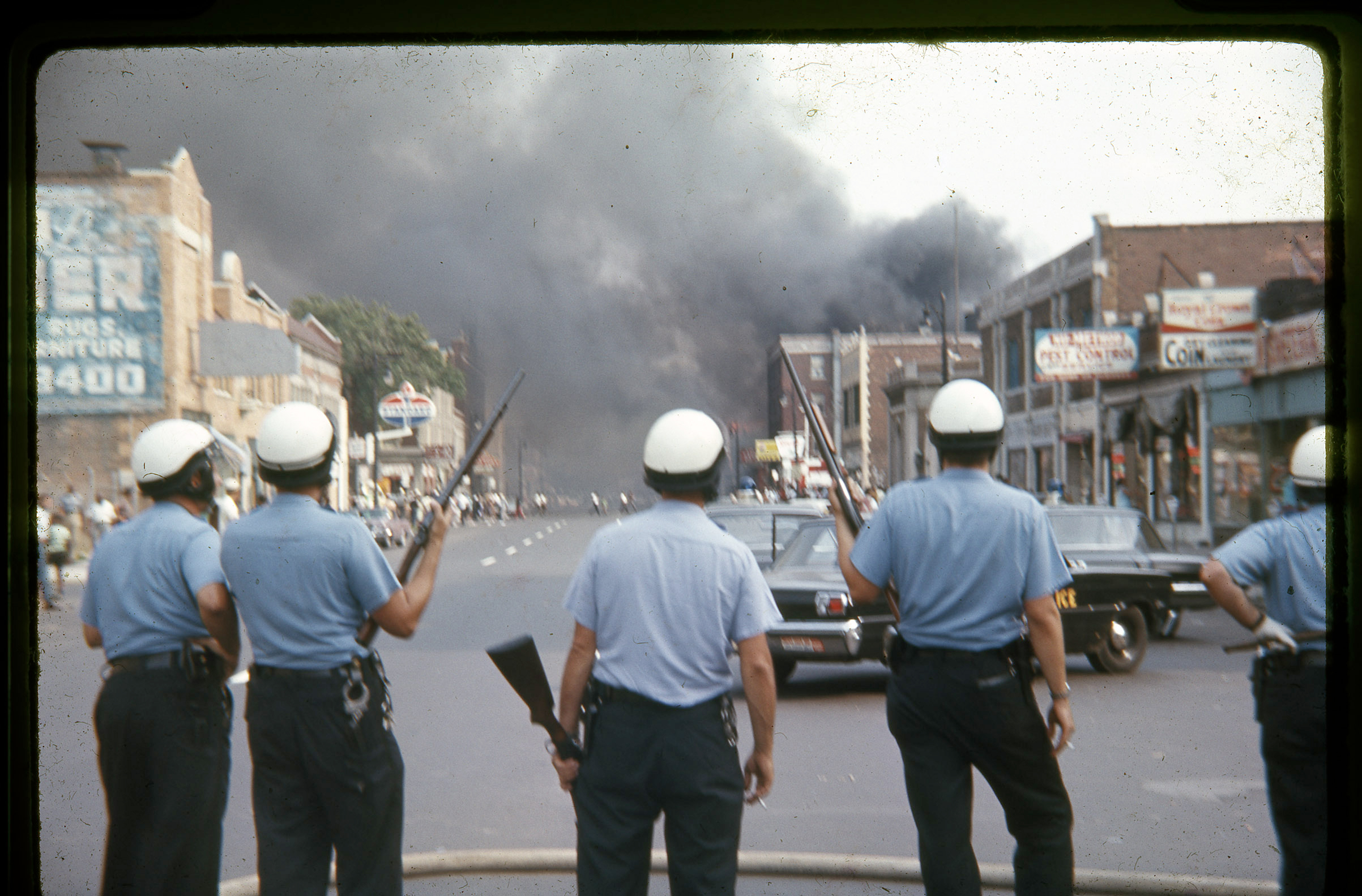 Detroit police officers standing on Linwood Avenue on the west side of Detroit during the July 1967 riots.