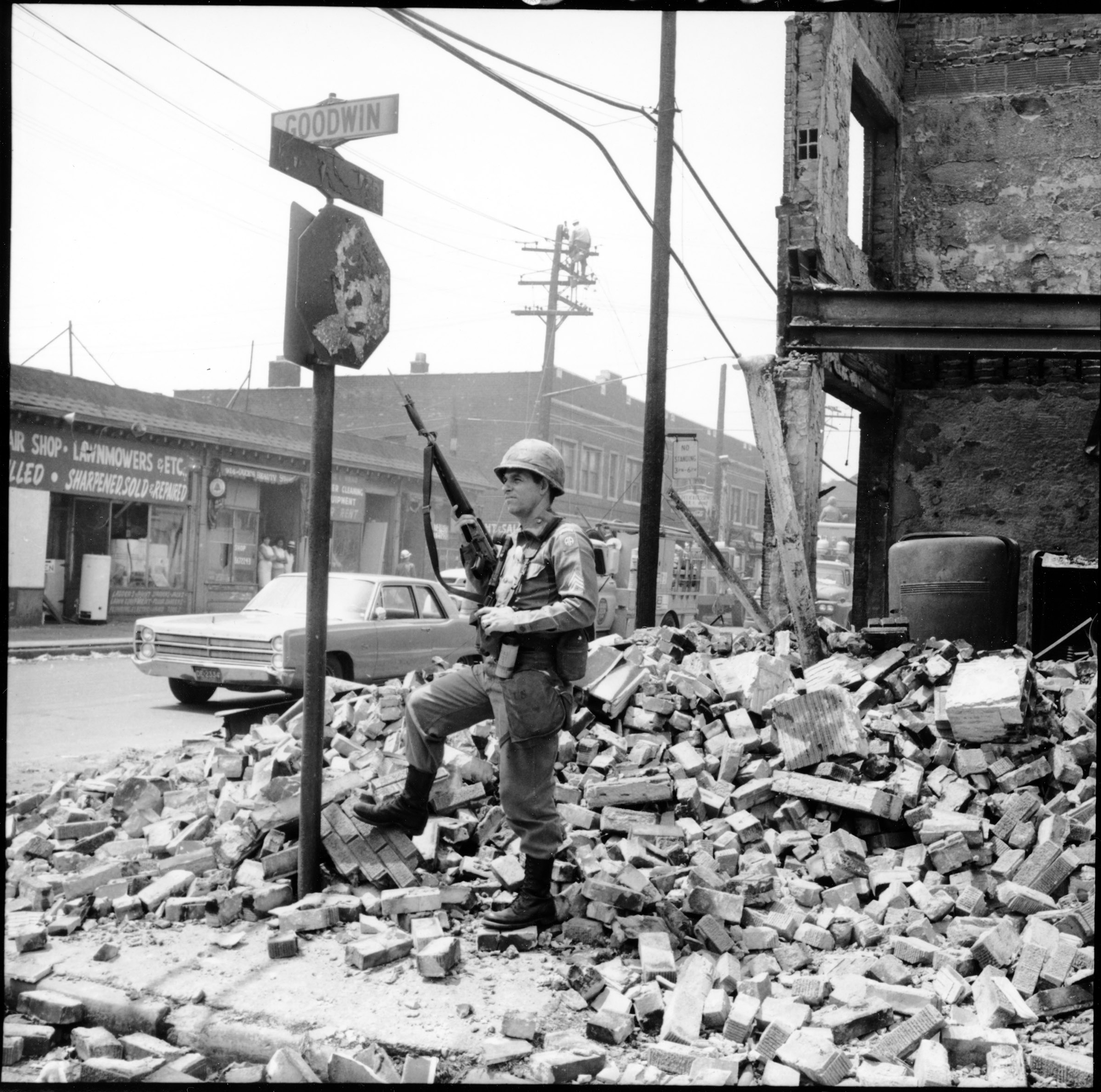 A member of the U.S. Airborne Division stands guard at the corner of Westminster and Goodwin Streets in Detroit during the violence and chaos that took place in July '67.