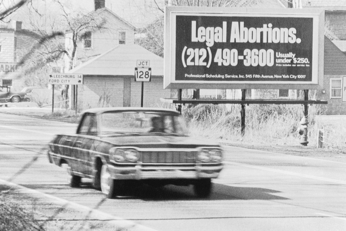 A billboard on Rt. 66 advertises legalized abortions in New York in 1971, during the period when abortion was only legal in some states.