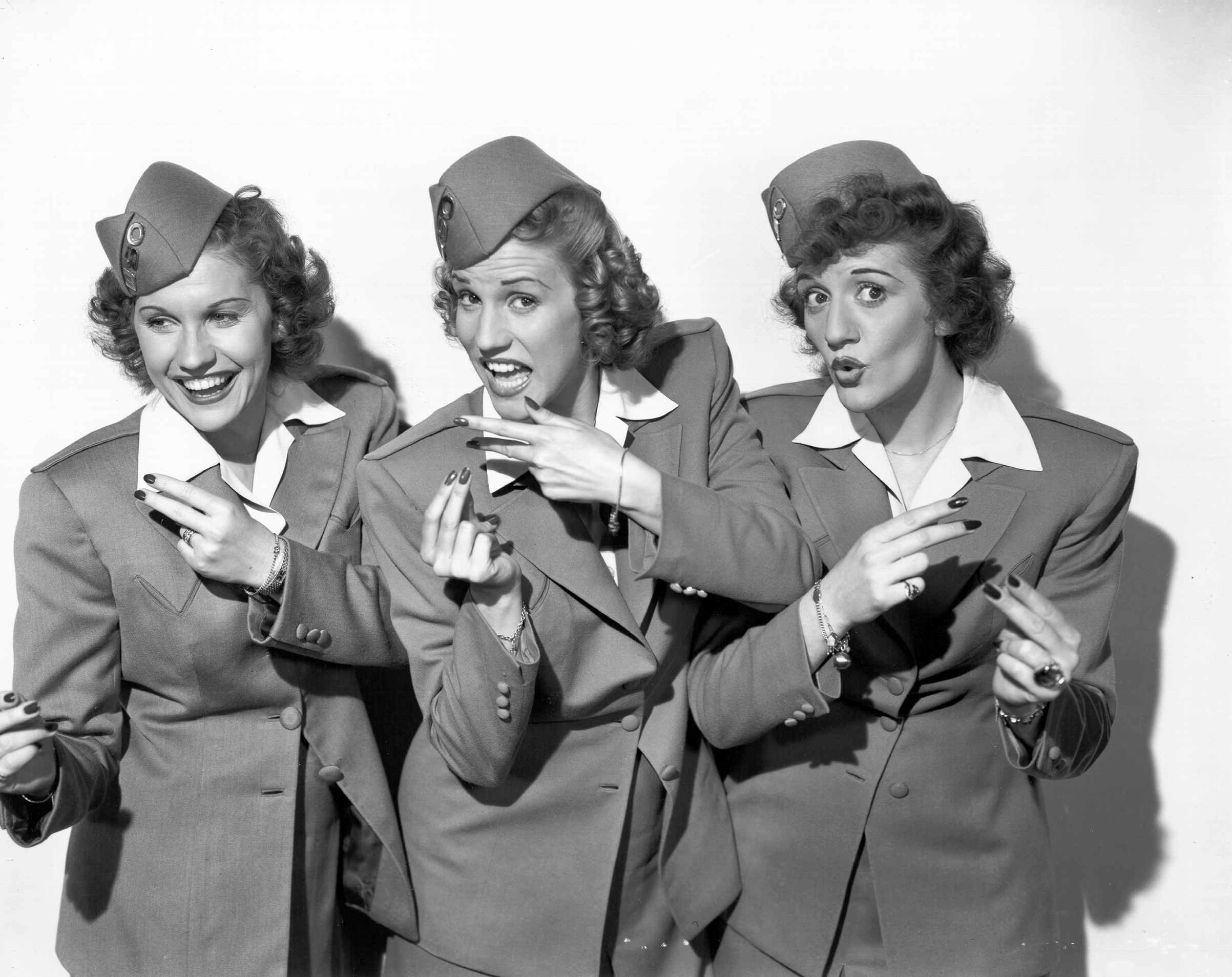 Singing group The Andrews Sisters (l-R Maxine Andrews, Patty Andrews, and LaVerne Andrews) pose for a portrait circa 1944 in New York City, New York.