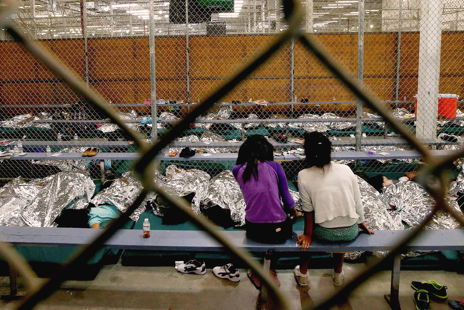 Two young girls held at a U.S. Customs and Border Protection Nogales Placement Center in Nogales, Ariz. Ross D. Franklin—AP Images