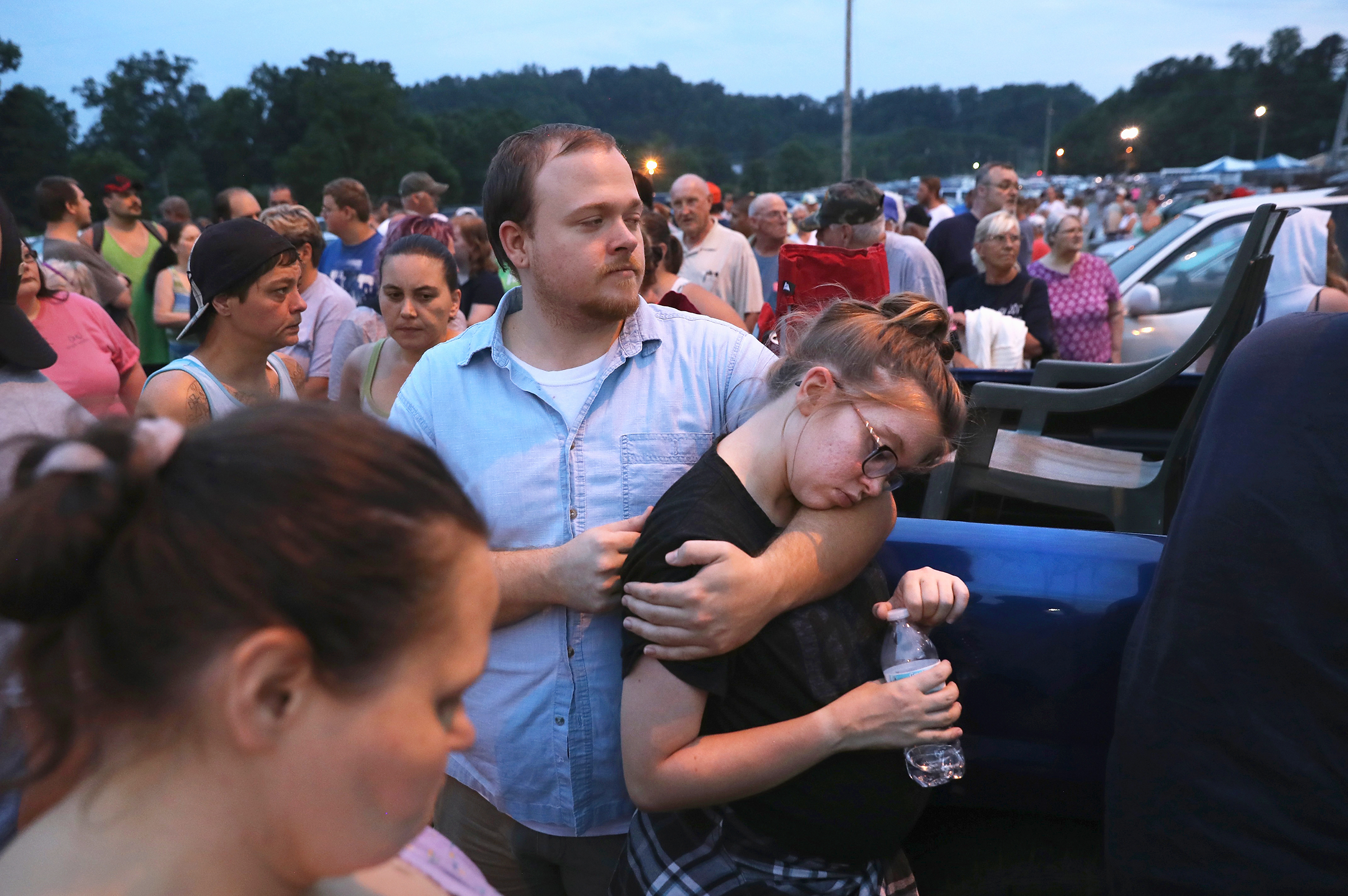 People wait to enter the Remote Area Medical (RAM) mobile clinic after sleeping in their cars on July 21, 2017 in Wise, Va.
