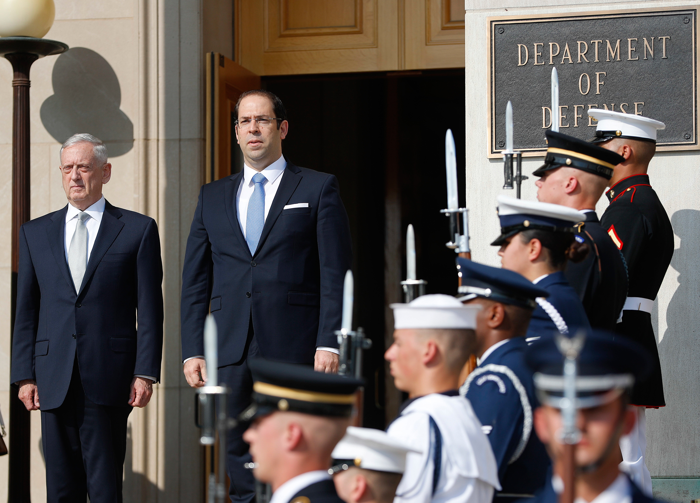 Defense Secretary Jim Mattis, left, hosts an enhanced honor cordon for Tunisian Prime Minister Youssef Chahed at the Pentagon, July 10, 2017.