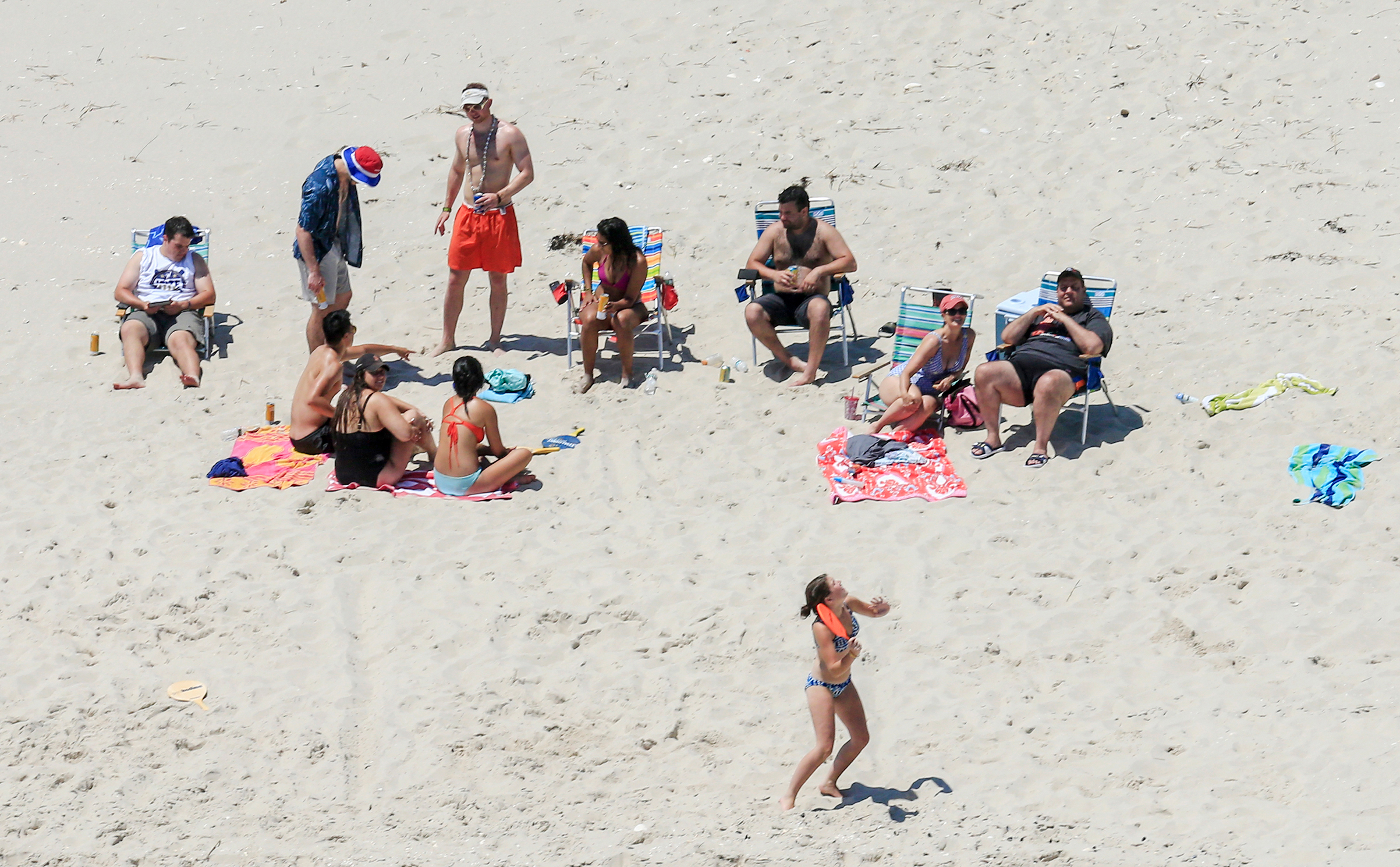 New Jersey Gov. Chris Christie, right, uses the beach with his family and friends at the governor's summer house at Island Beach State Park in New Jersey on July 2, 2017.