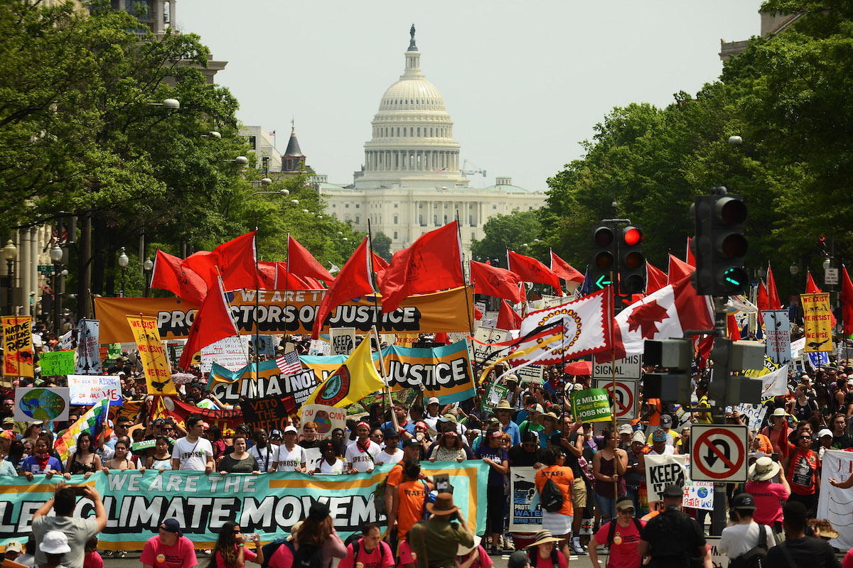 People march from the U.S. Capitol to the White House for the People's Climate Movement protest on April 29, 2017 in Washington, DC.