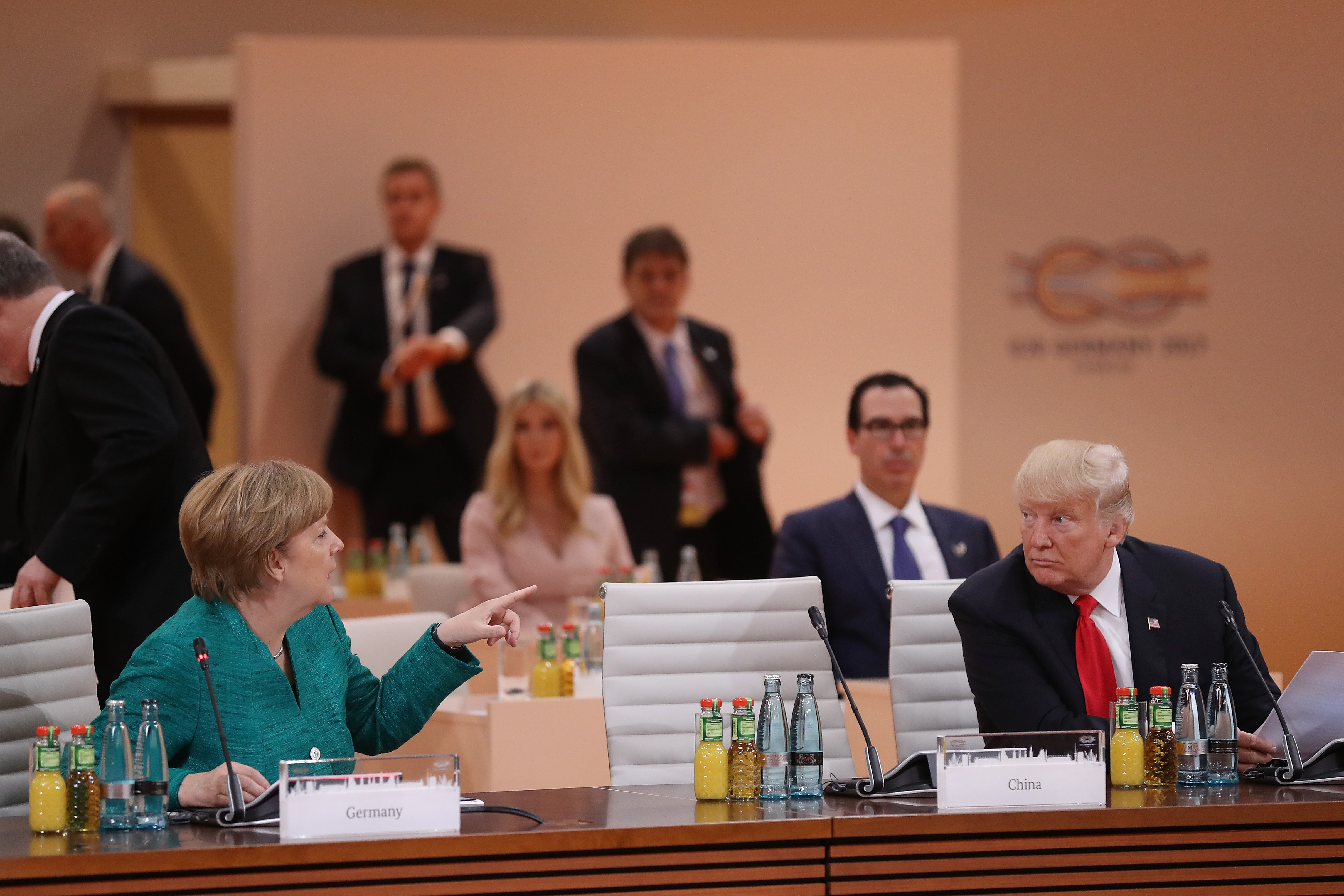 German Chancellor Angela Merkel and U.S. President Donald Trump attend the morning working session on the second day of the G20 economic summit on July 8 in Hamburg, Germany.