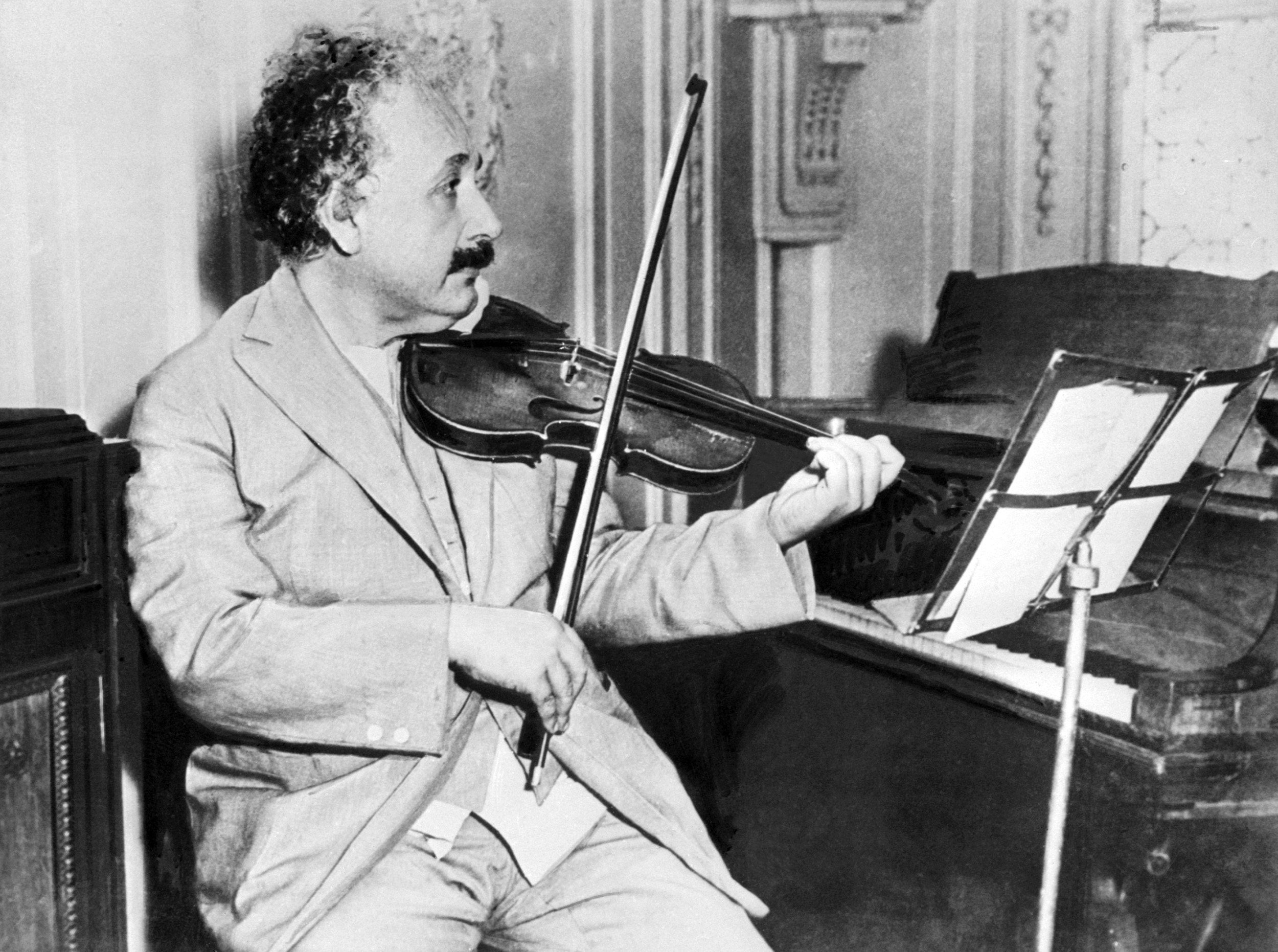 German-born Swiss-American physicist Albert Einstein (1879–1955), author of theory of relativity, awarded the Nobel Prize for Physics in 1921, playing the violin in 1931.