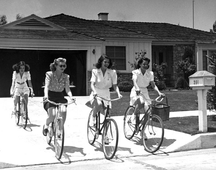 Actress Rita Hayworth (2R) riding bikes with her friends Minerva Griswold, Jane Hopkins and Virginia Hovey, 1940.