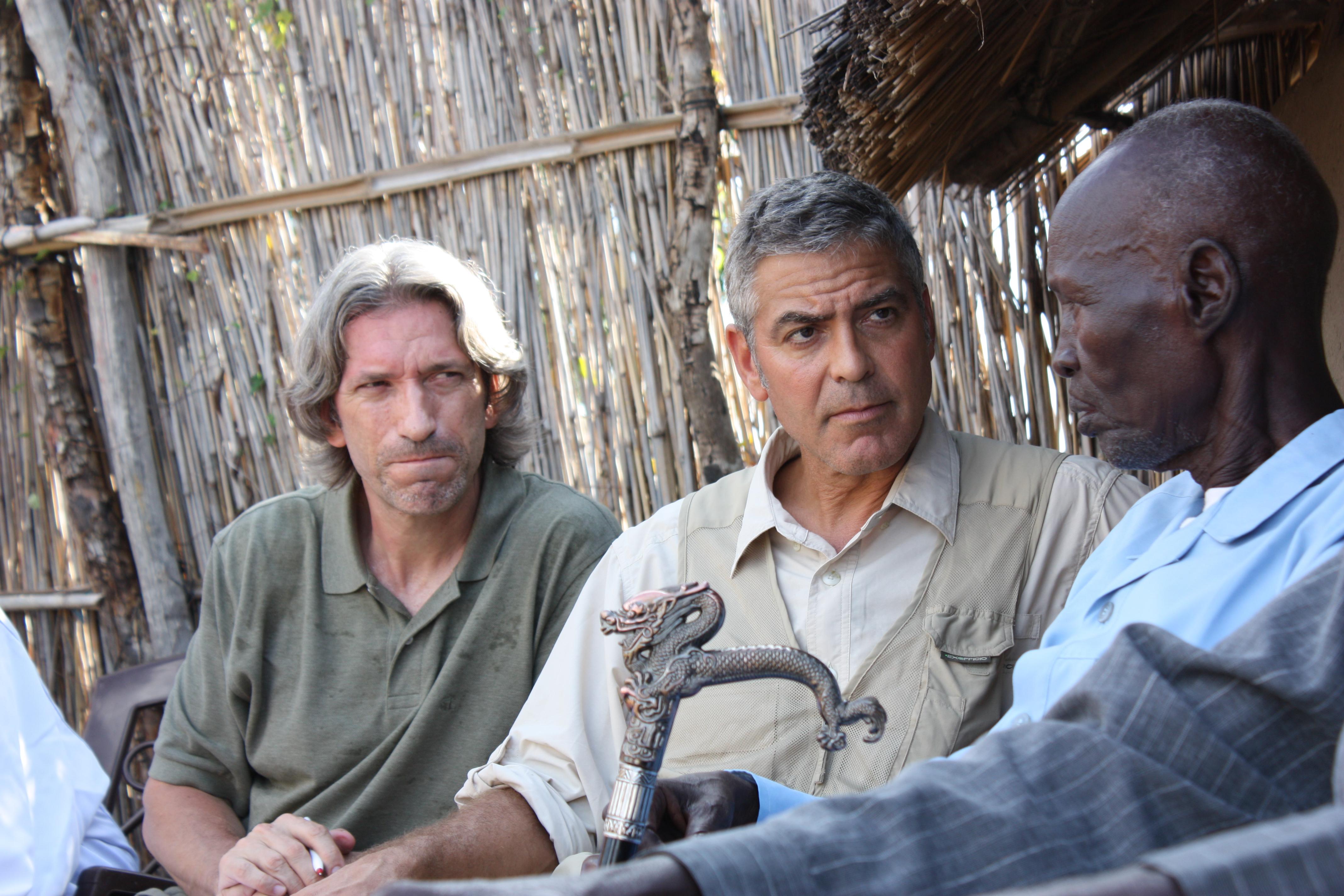 Prendergast, left, and Clooney meet with Sudanese elders