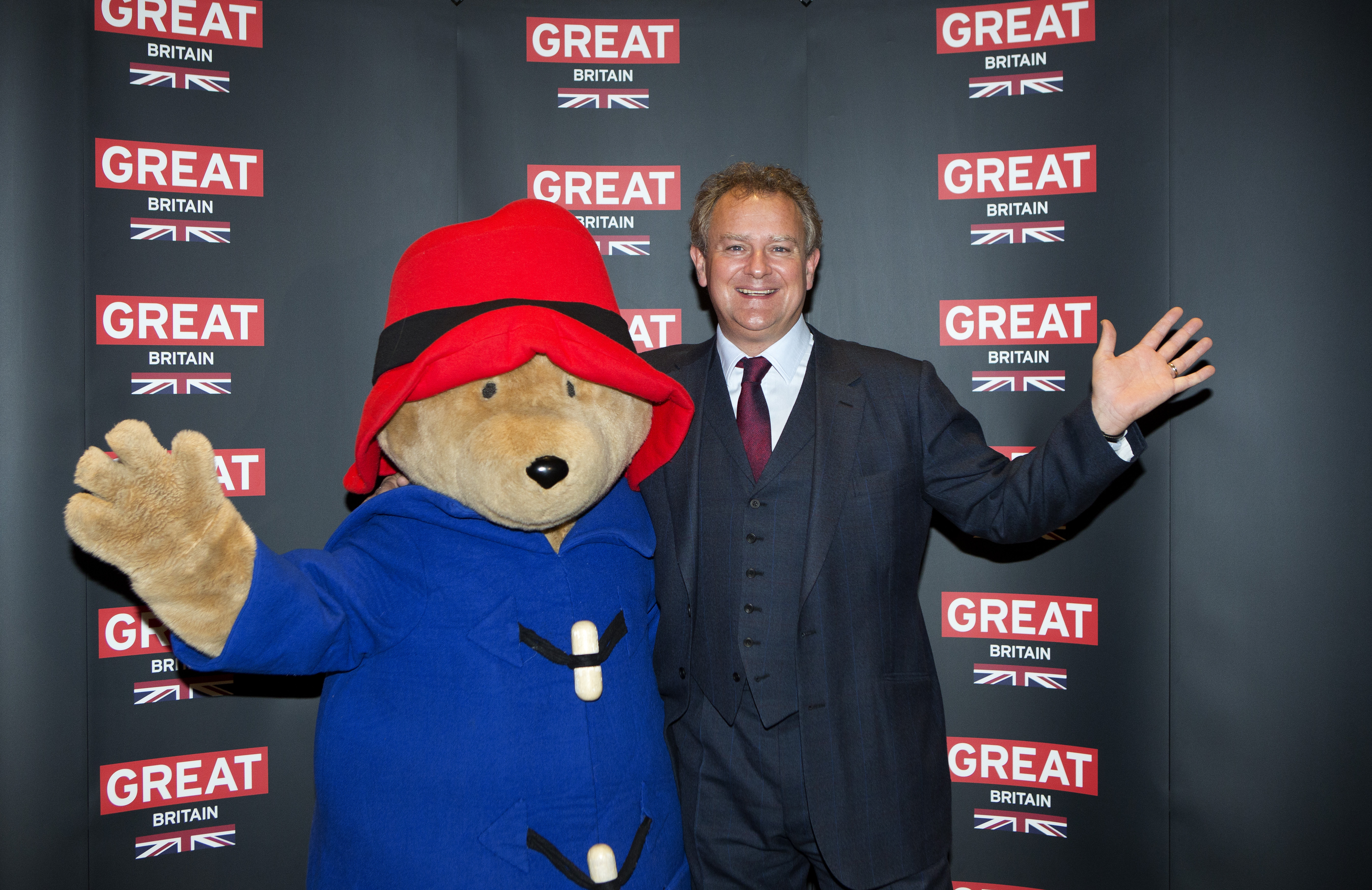 Actor Hugh Bonneville poses with a person dressed as Paddington Bear during the photo call for the film Paddington Bear at The British Embassy in Berlin, during the International Film Festival Berlinale, Feb. 7, 2014.